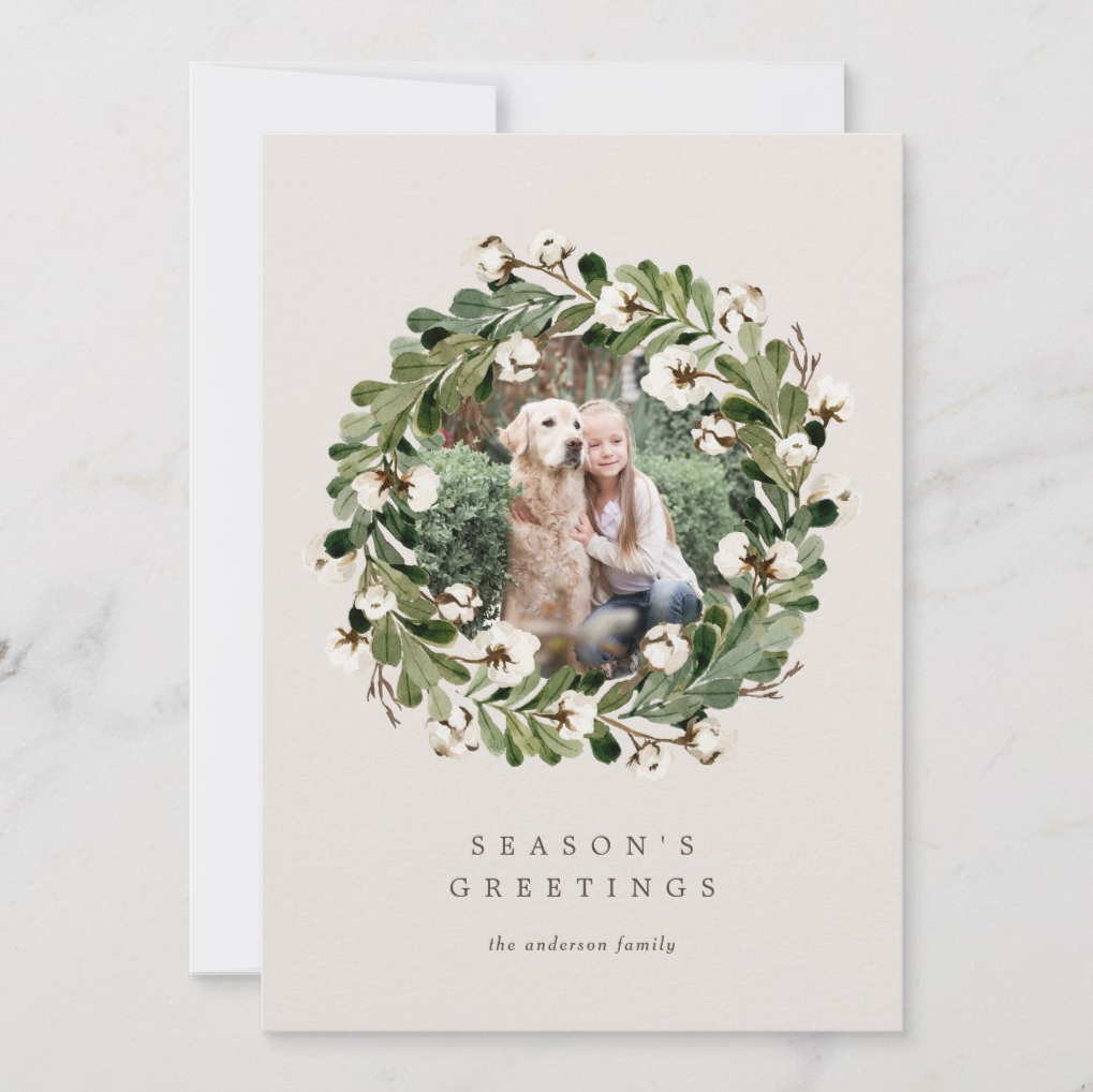 Simply beautiful, this holiday card puts your favorite photo in a wreath of cotton and greenery giving it a sweetly simple Southern vibe.   Southern Cotton Wreath by Fine and Dandy Paperie