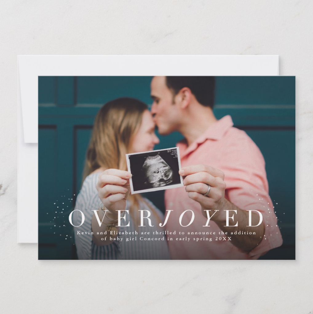 A fantastic way to announce a pregnancy, marriage or anything at all, this photo card feels sophisticated with elegant typography and festive with the little snowy accents.   Overjoyed by Lea Delaveris Design
