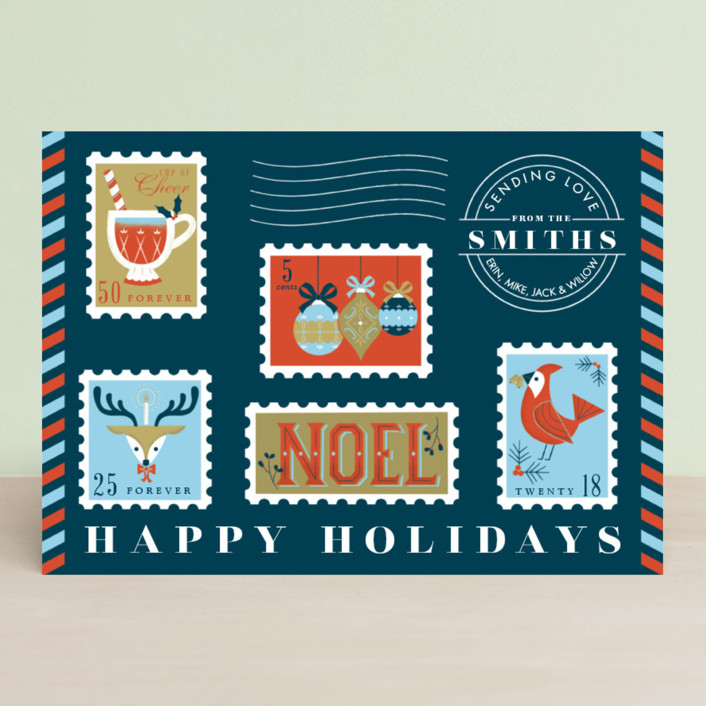 Like an airmail envelope, this design has all the charm of the vintage postage stamps.  Sending Holiday Spirit by Green Hound Press