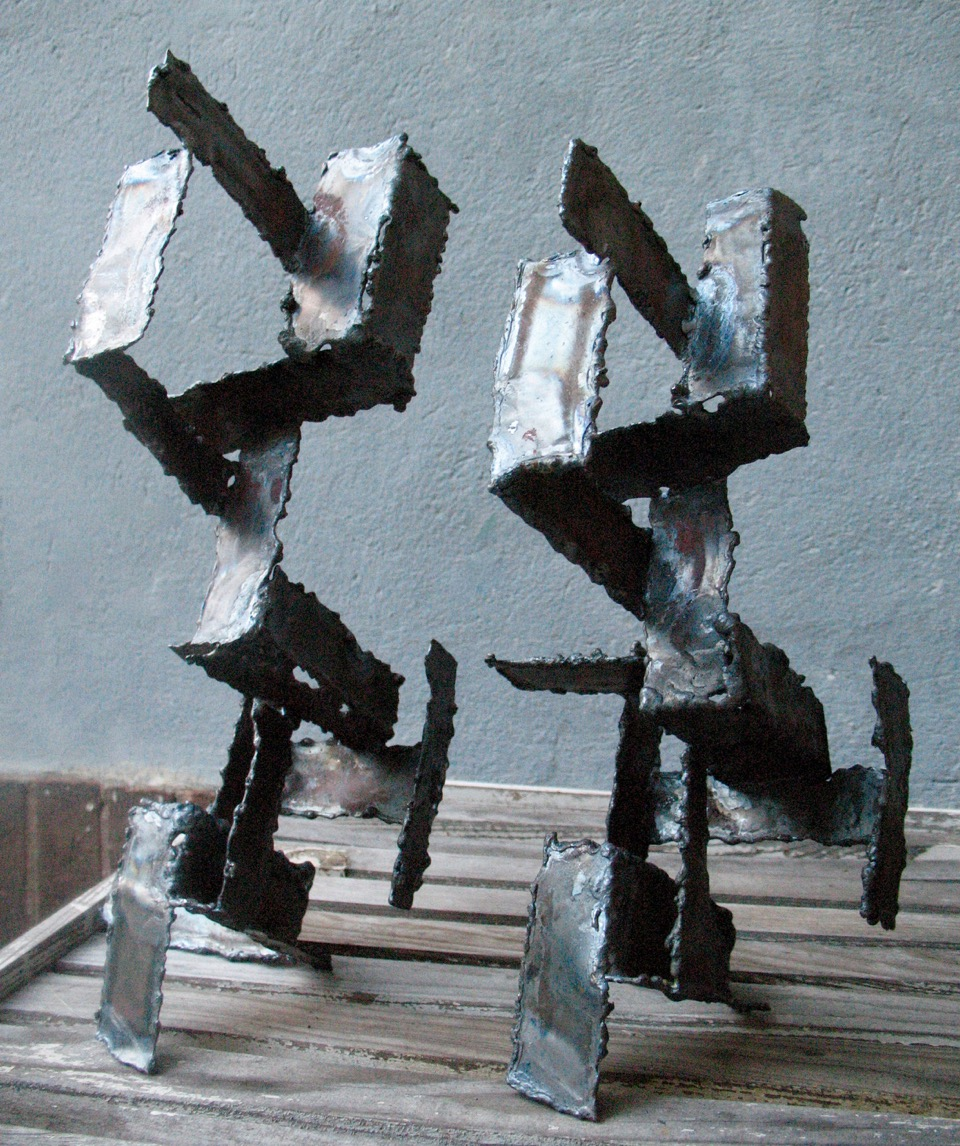 Double Bays  by Emily McCormick    Welded, heat-treated mild steel - a. 11'' x 7'' x 15'' b. 9.5'' x 6.5'' x 13.25''  (2015)
