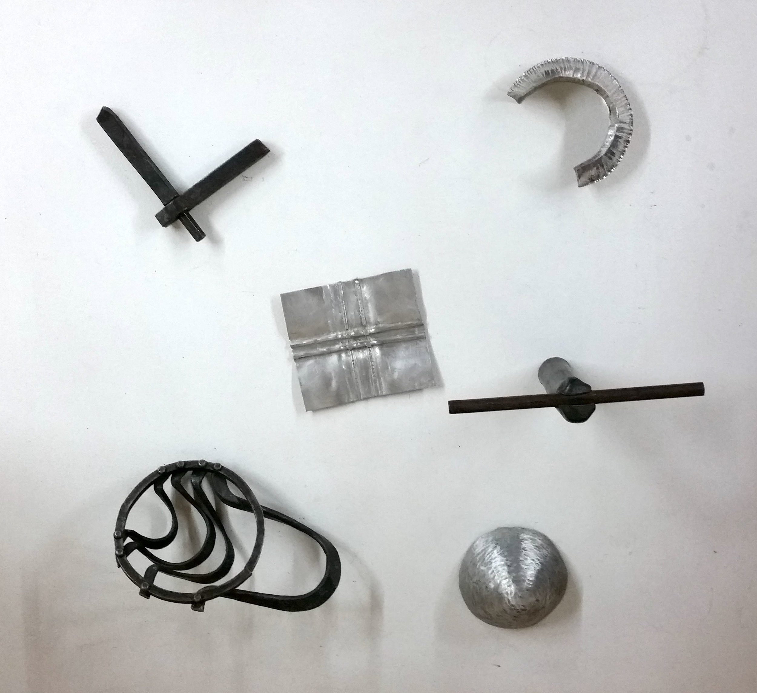 Sarah Holden,  Teaching Samples: Rivets, Mortise and Tenon, Alternate Connection, Foldforming, and Angle Raising , Aluminum and mild steel