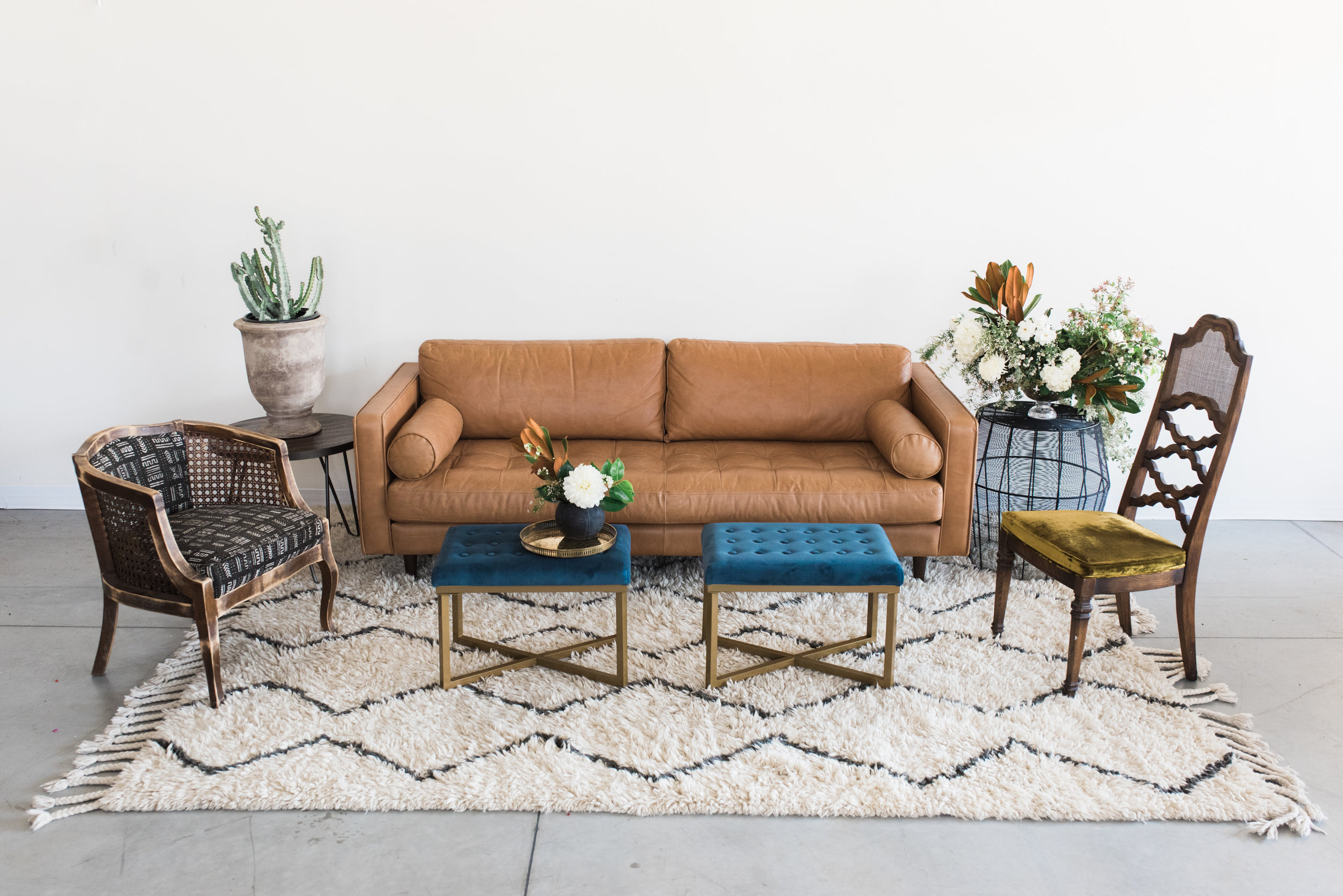 Furniture with pillows, rugs and poufs: $770  Furniture only: $570  ***Potted plants, vases of flowers, bowls of fruit and books are not included.
