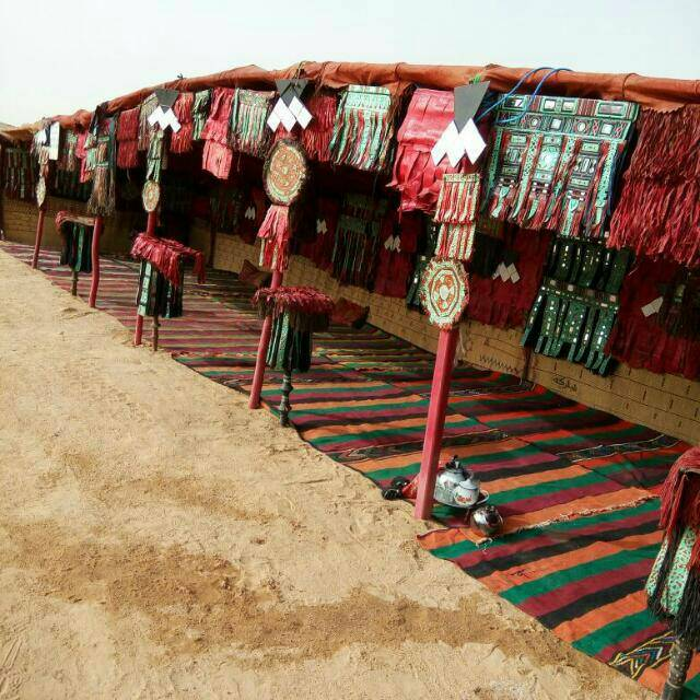 Ali travels between Niger and Benin just about once a month. His family lives in Niger and his business is in Benin. He sent us this photo last month of a place where ceremonies are held. Isn't it beautiful? I love the colors.