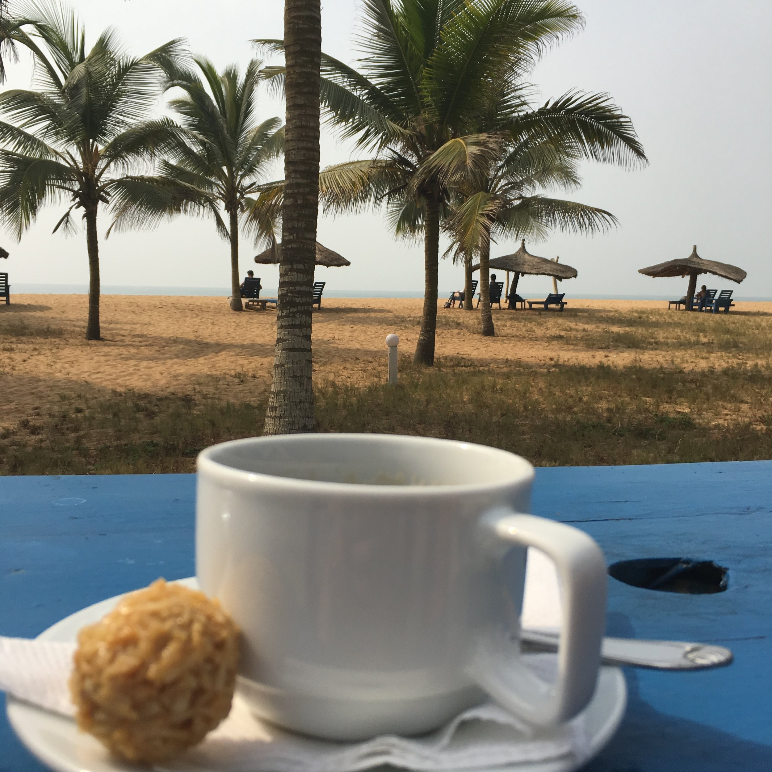 A great cup of coffee and a coconut macaroon at the Auberge in Grand Popo, Benin.