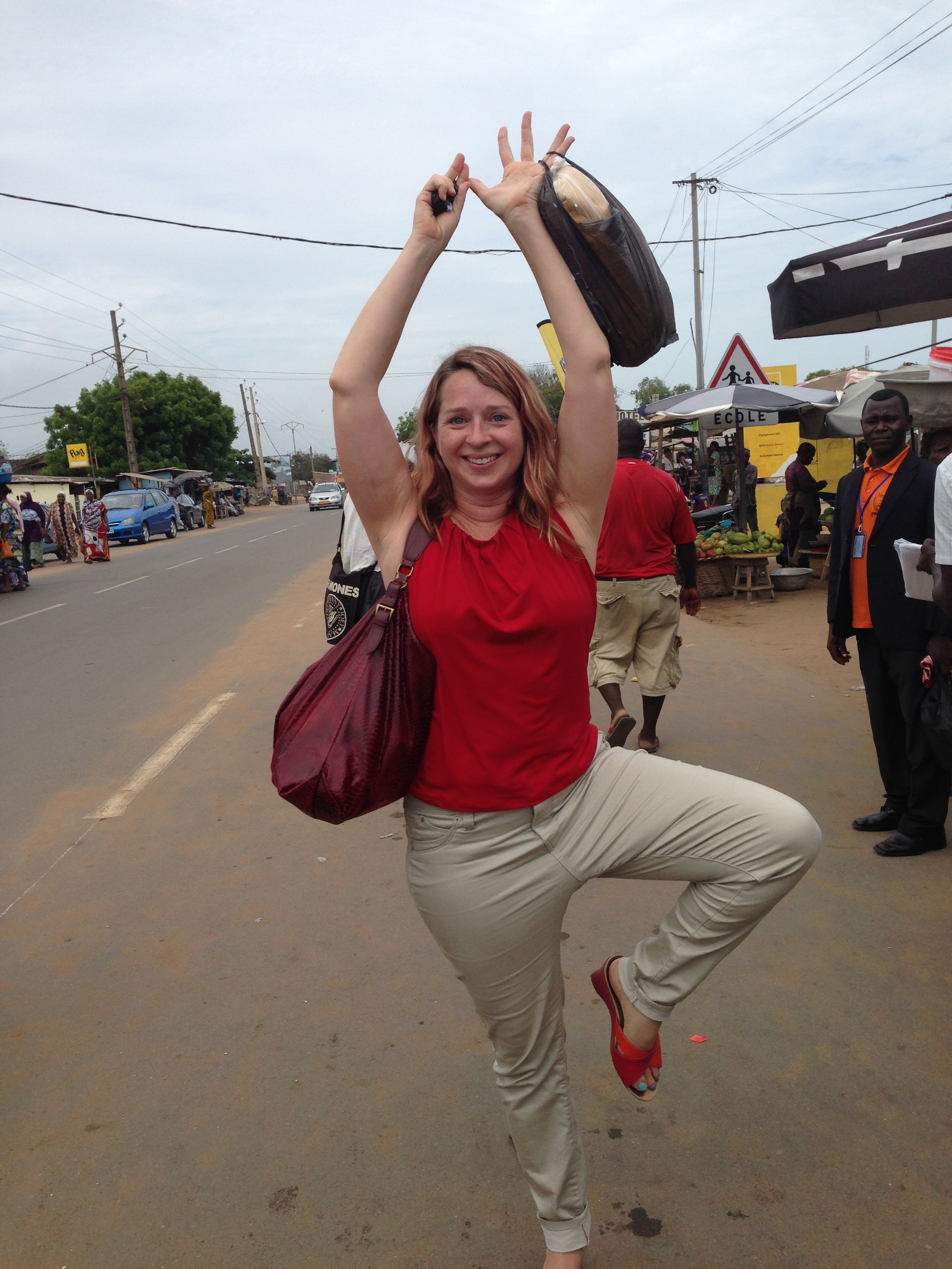 Me doing a little bit of tree pose at the Togo/Benin border back in 2016. Image captured by my friendly Nigerian seat mate on the bus.