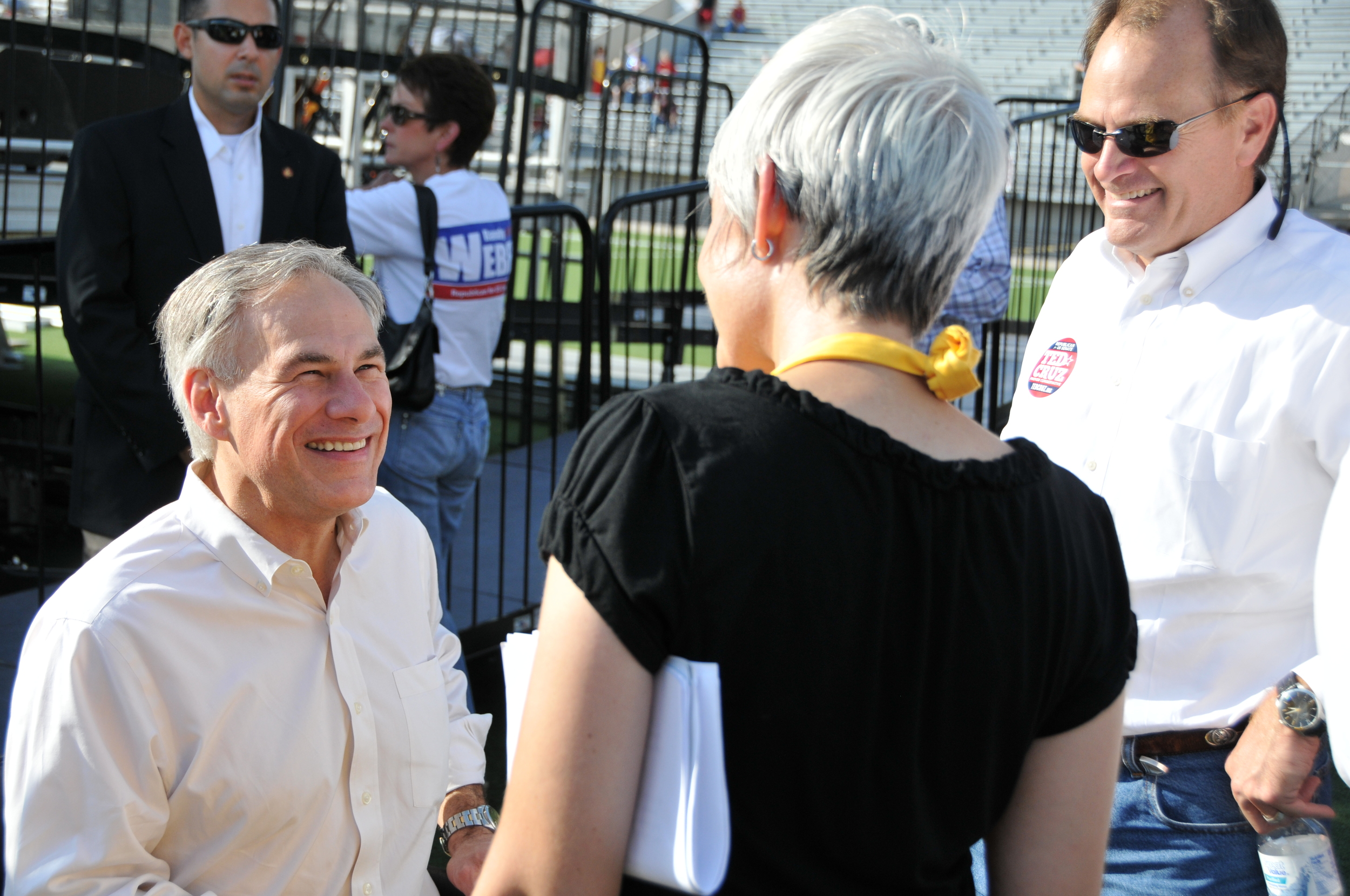 Texas Patriots PAC President Julie Turner chats with Greg Abbott and State Representative Steve Toth backstage at our rally in Conroe - November 2012.