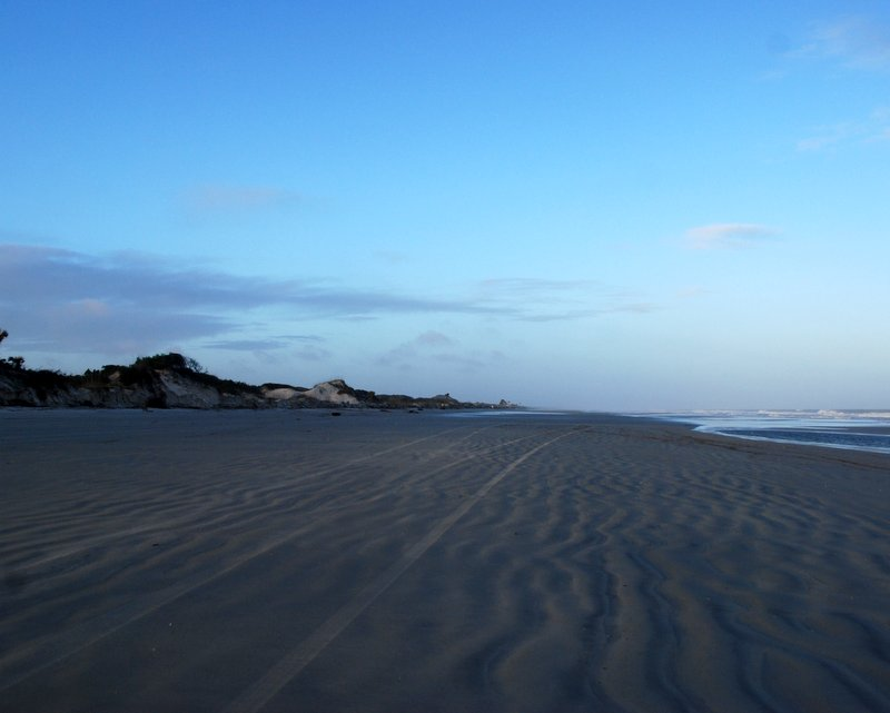 When we returned this morning the water was cutting away at those distant dunes.