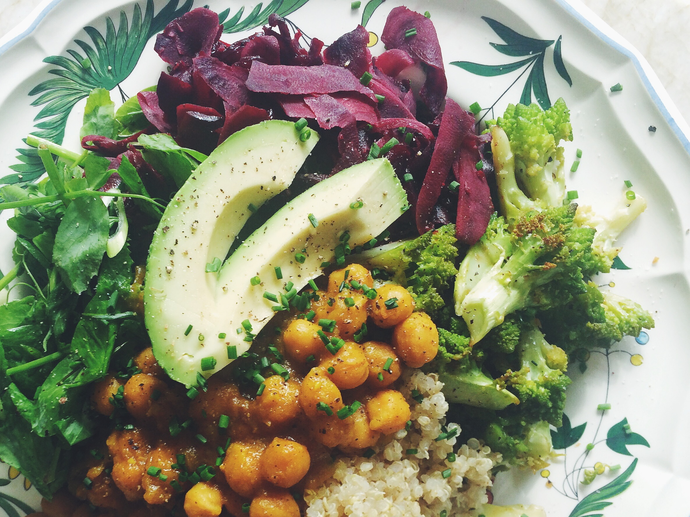 Curried Chickpea Bowl with Beet Ribbon Slaw, Citrusy Pea Tendrils, Air-Fried Romanesco + Sprouted Quinoa
