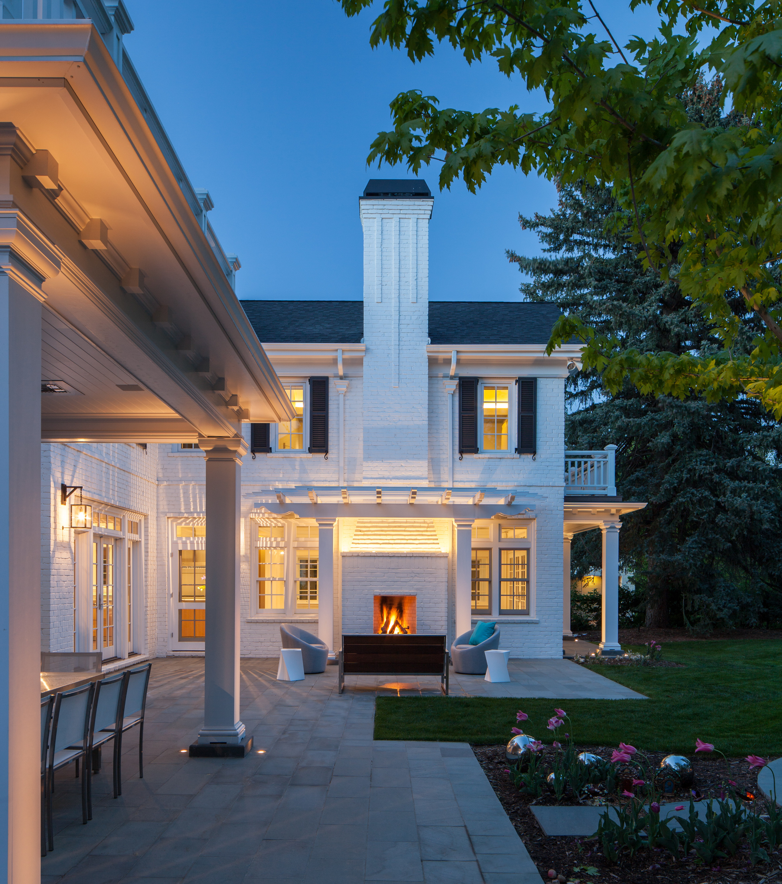 colonial_home_denver_night_side_view.jpg