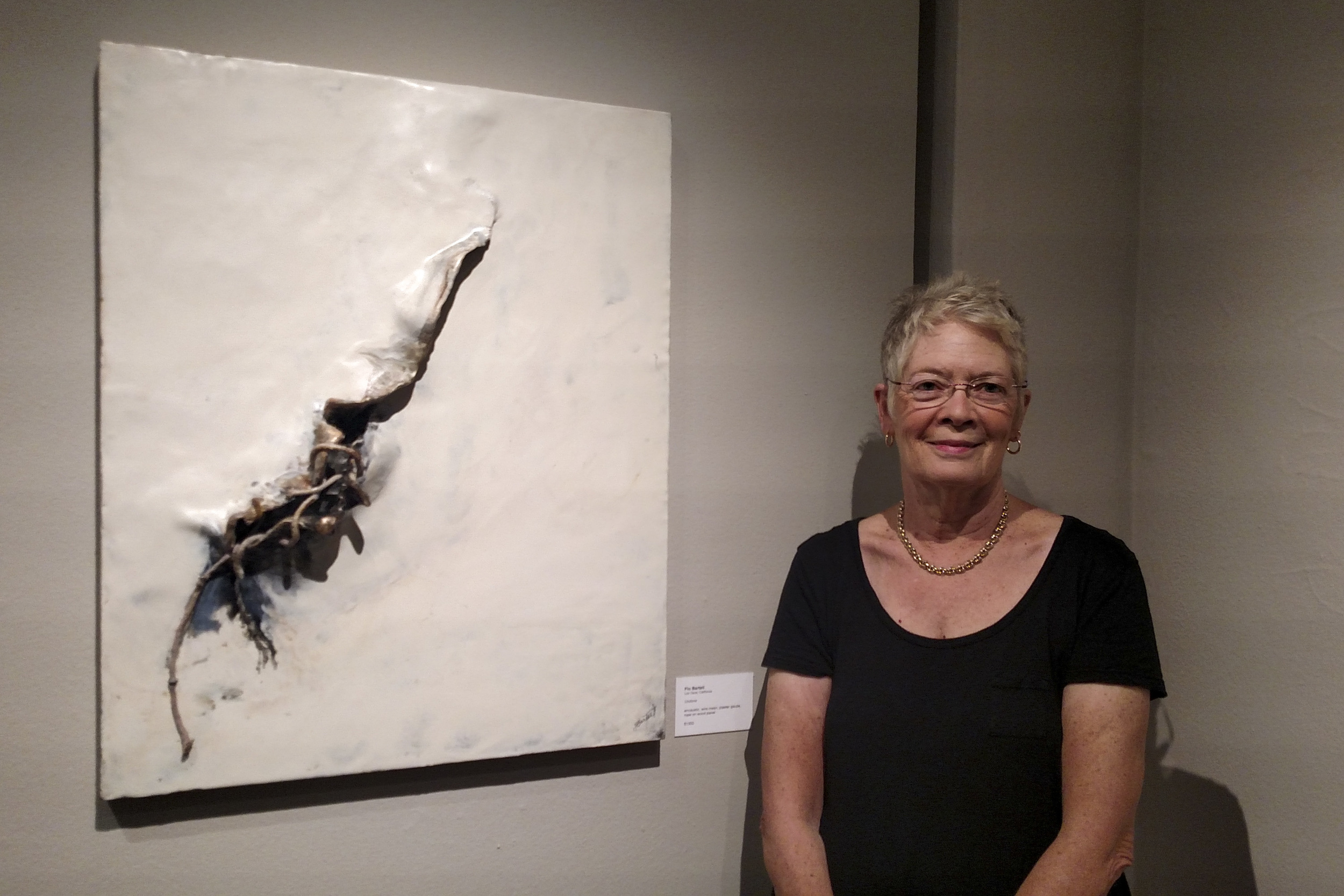Flo Bartell  beside one of her pieces selected for the exhibit...