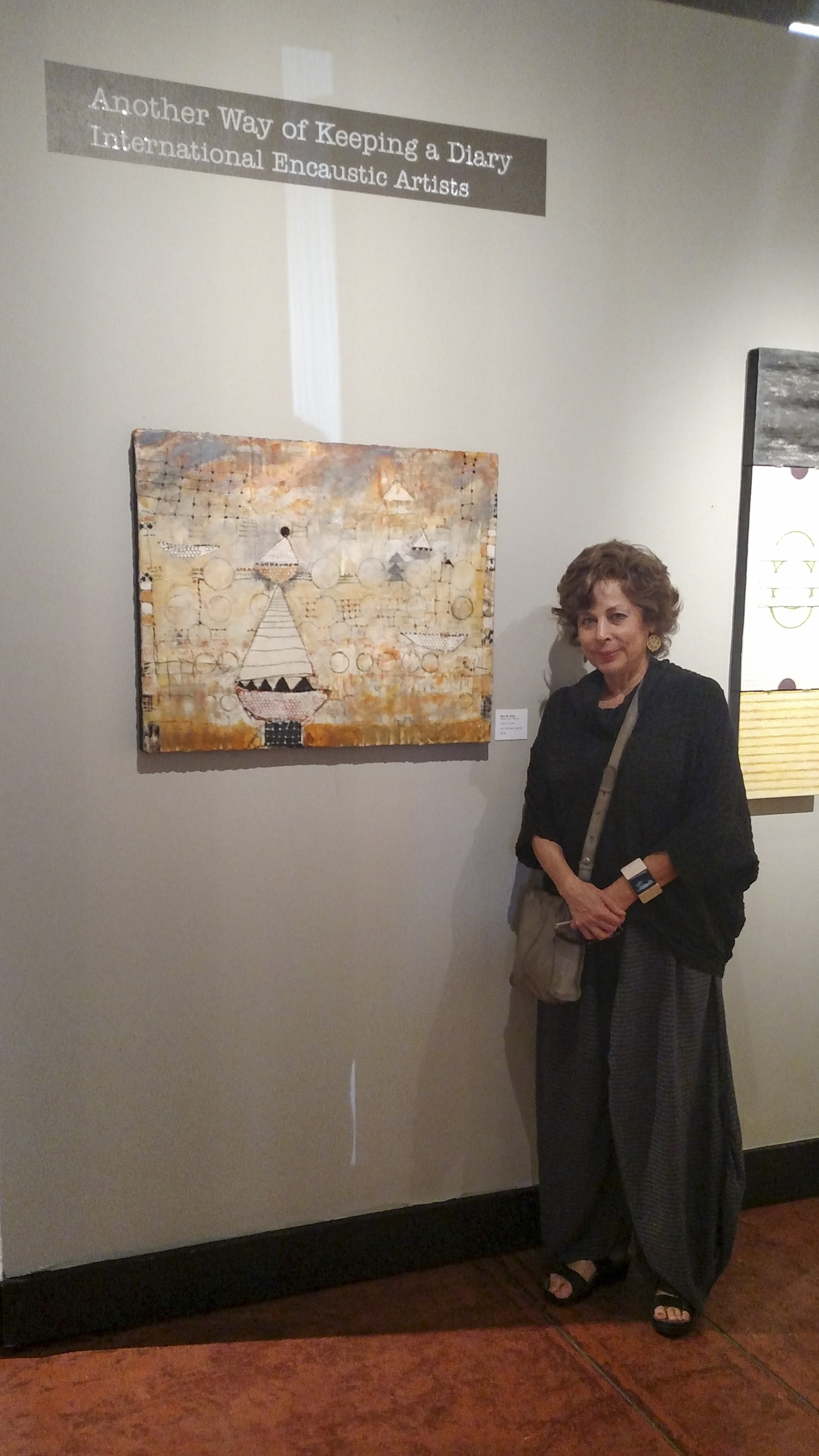 Mira M. White , next to her piece in the show...