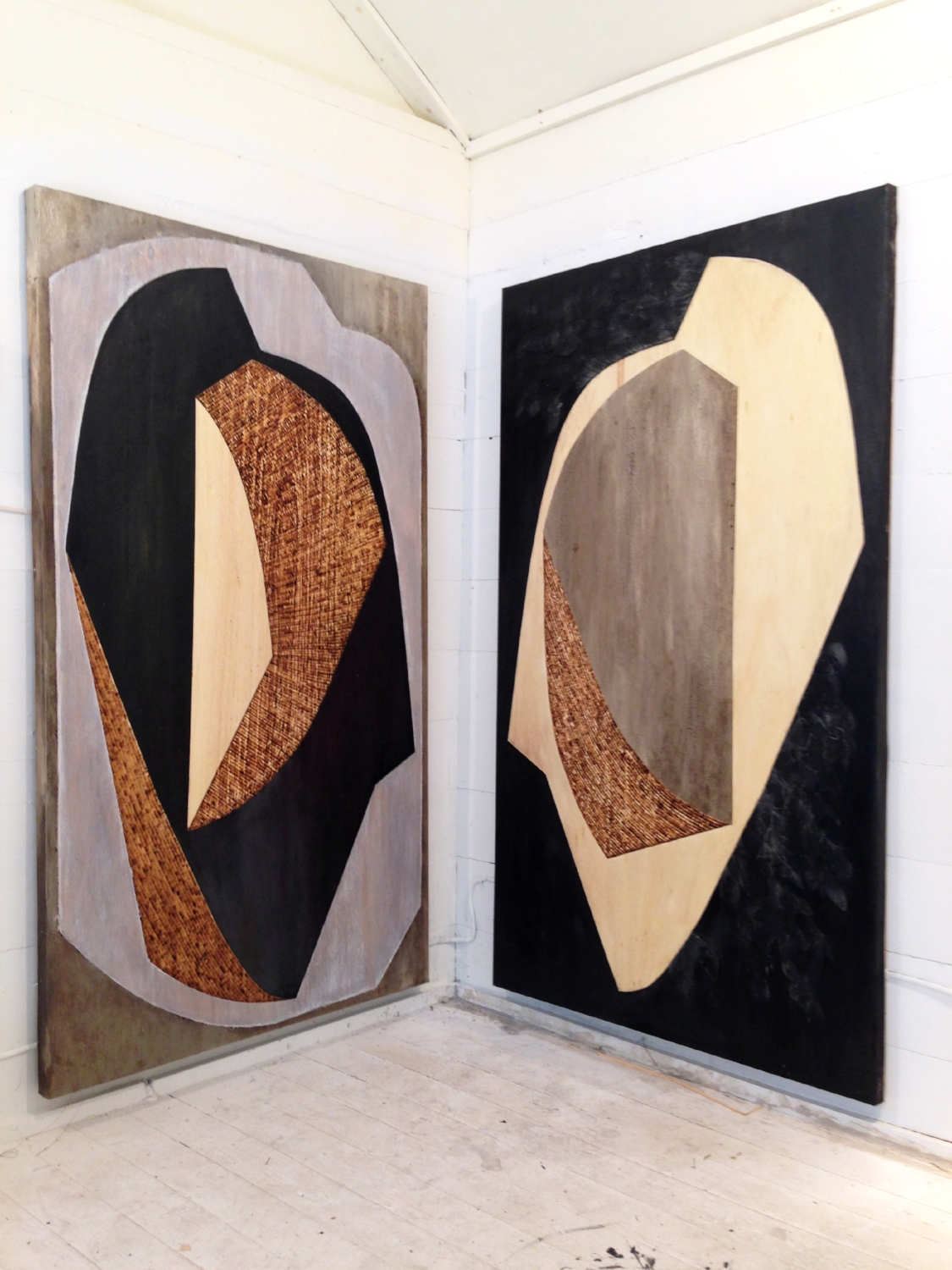 2015  Two Truths in the Same House  Tarpaper, enamel paint, and wood burning on birch panel.