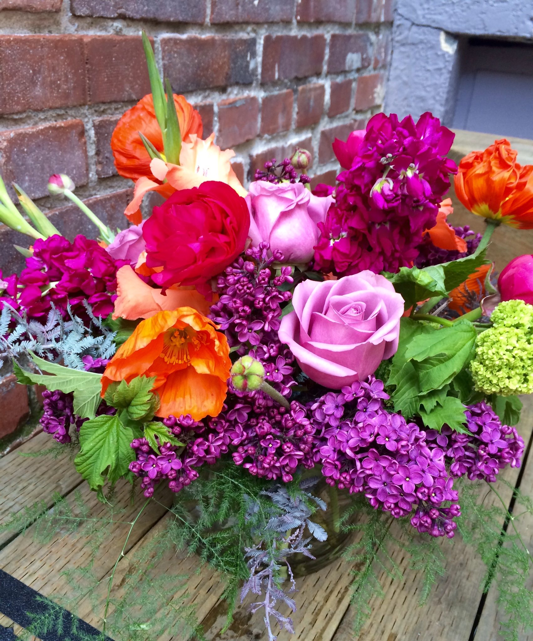 Bold and Vibrant with Lilac, Poppies, Viburnum and Ranunculus