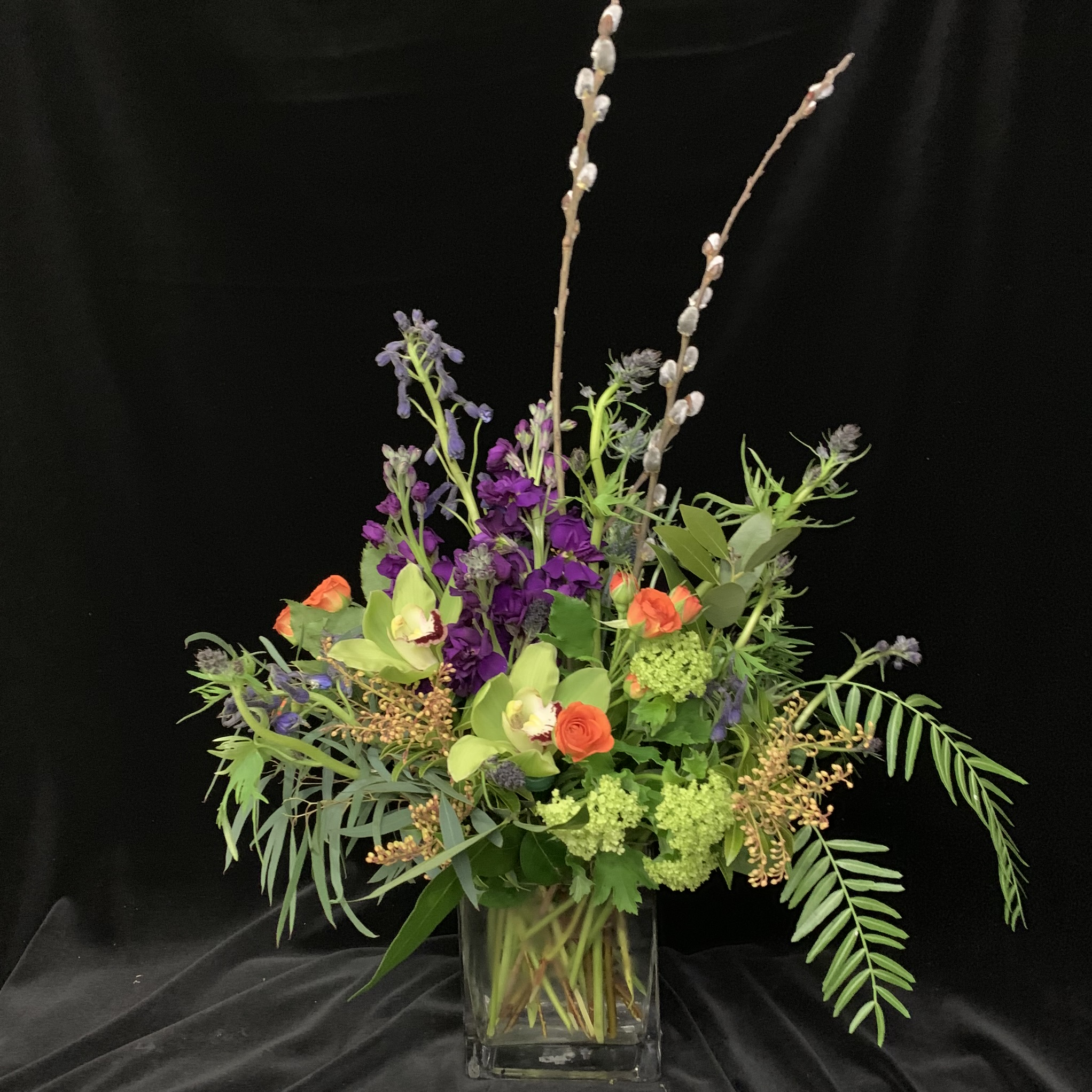 27. Natural overflowing centerpiece in purple, green and orange