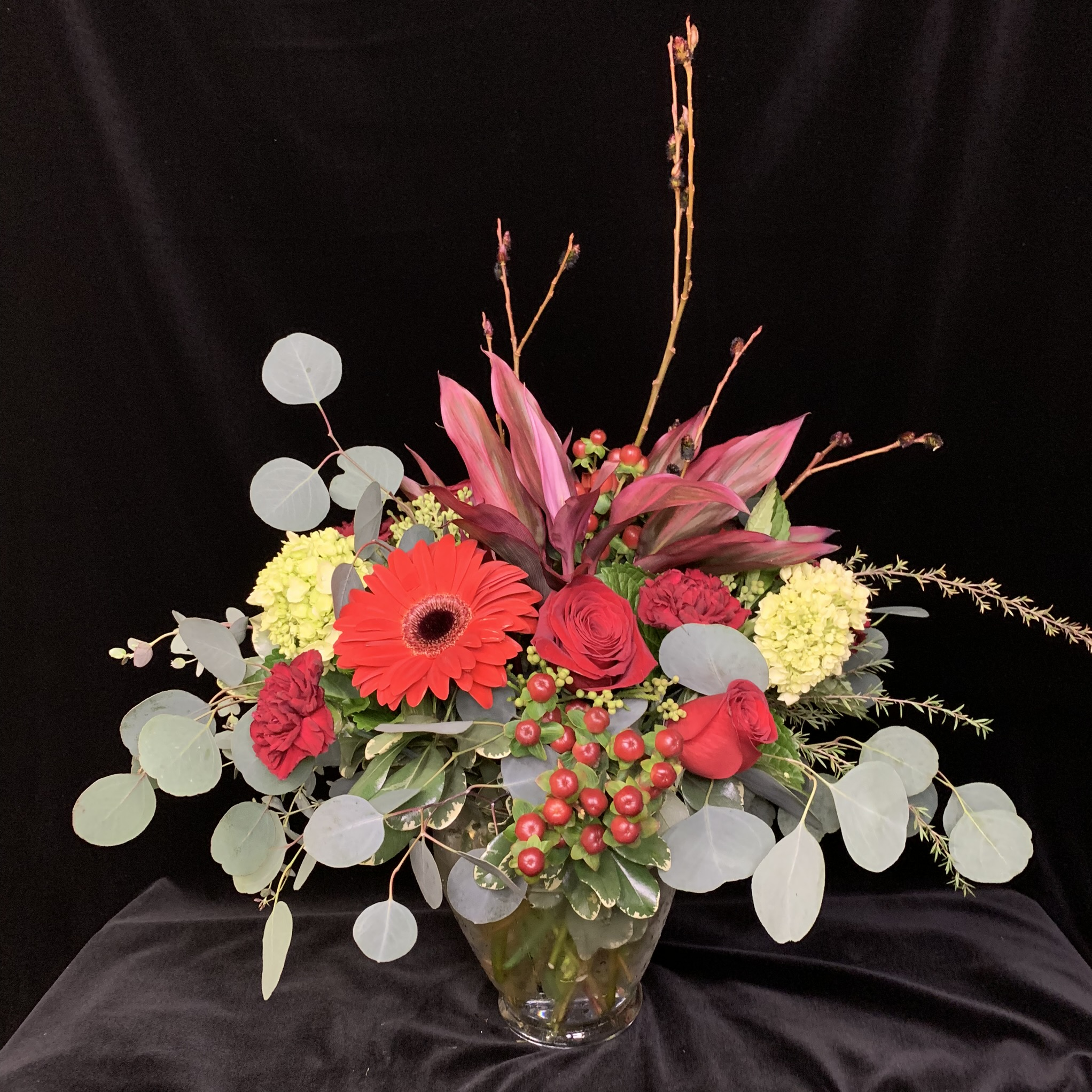 26. Dramatic reds and burgundy with eucalyptus