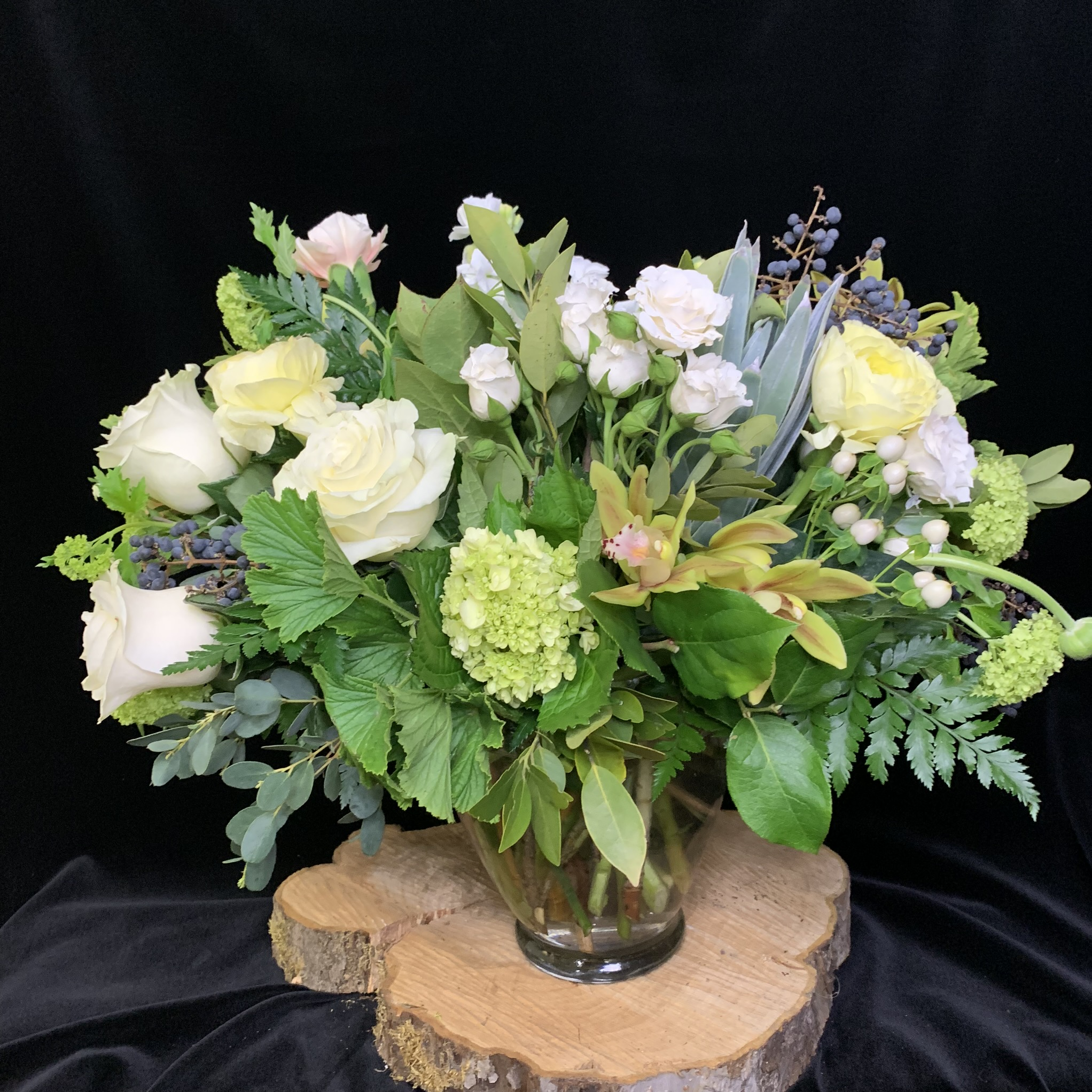 30. Soft lush overflowing bouquet in neutral creams and greens