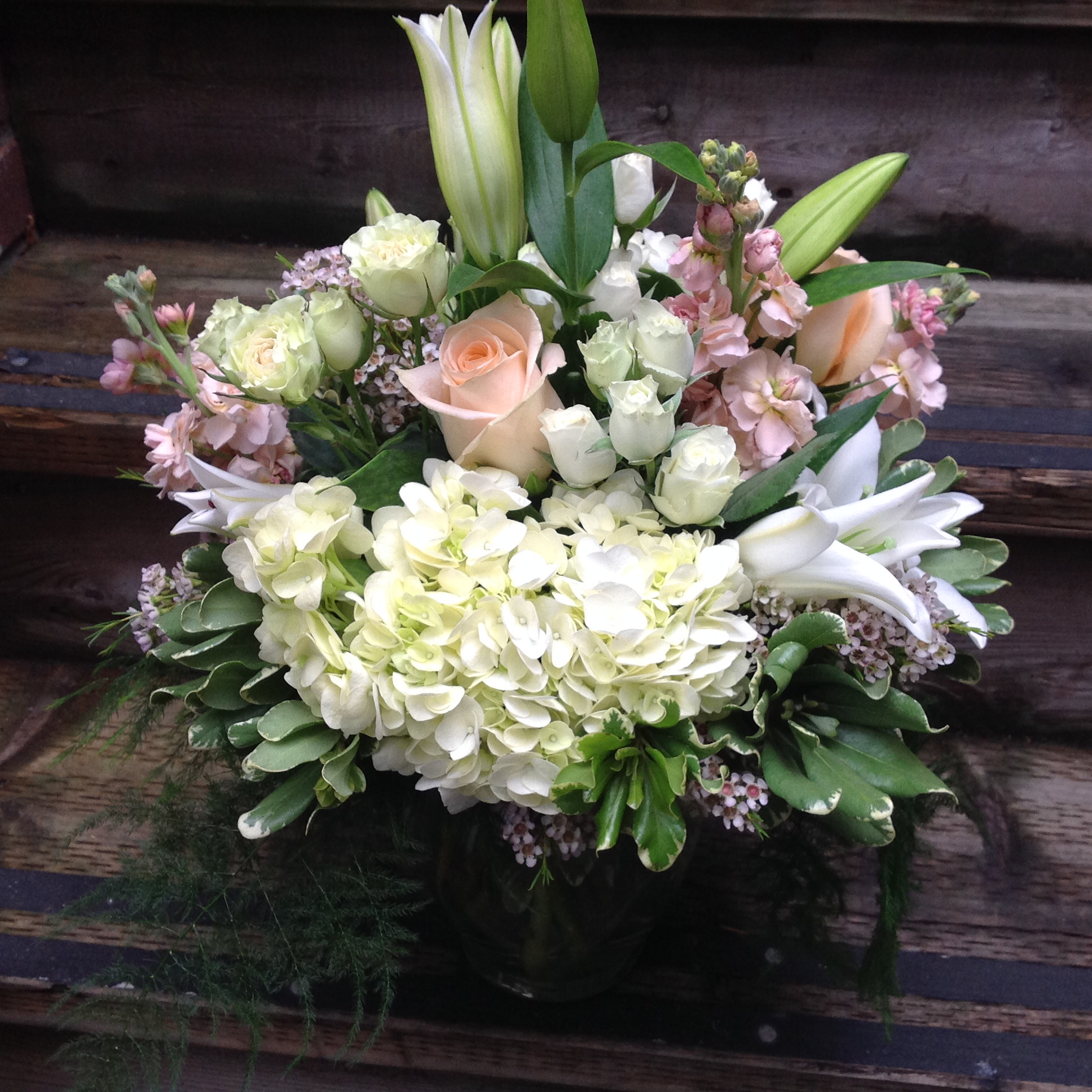 38. lush rounded bouquet with soft lavender and cream accent