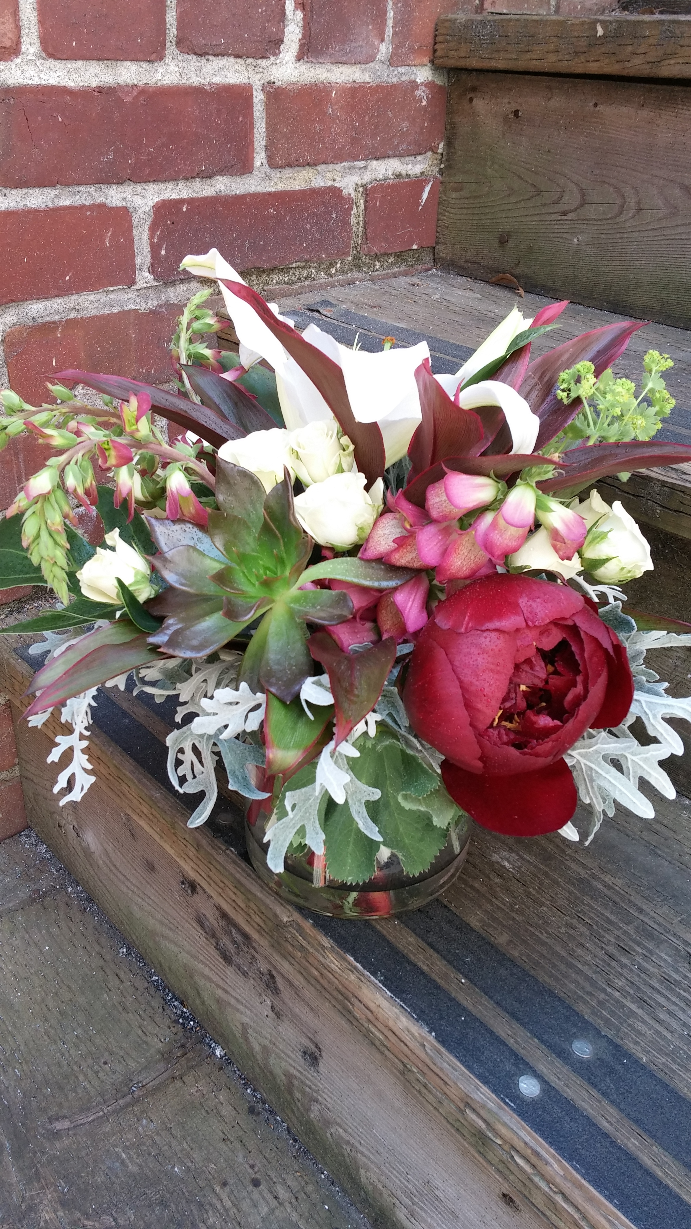 6. Muted bouquet with peony and succulent