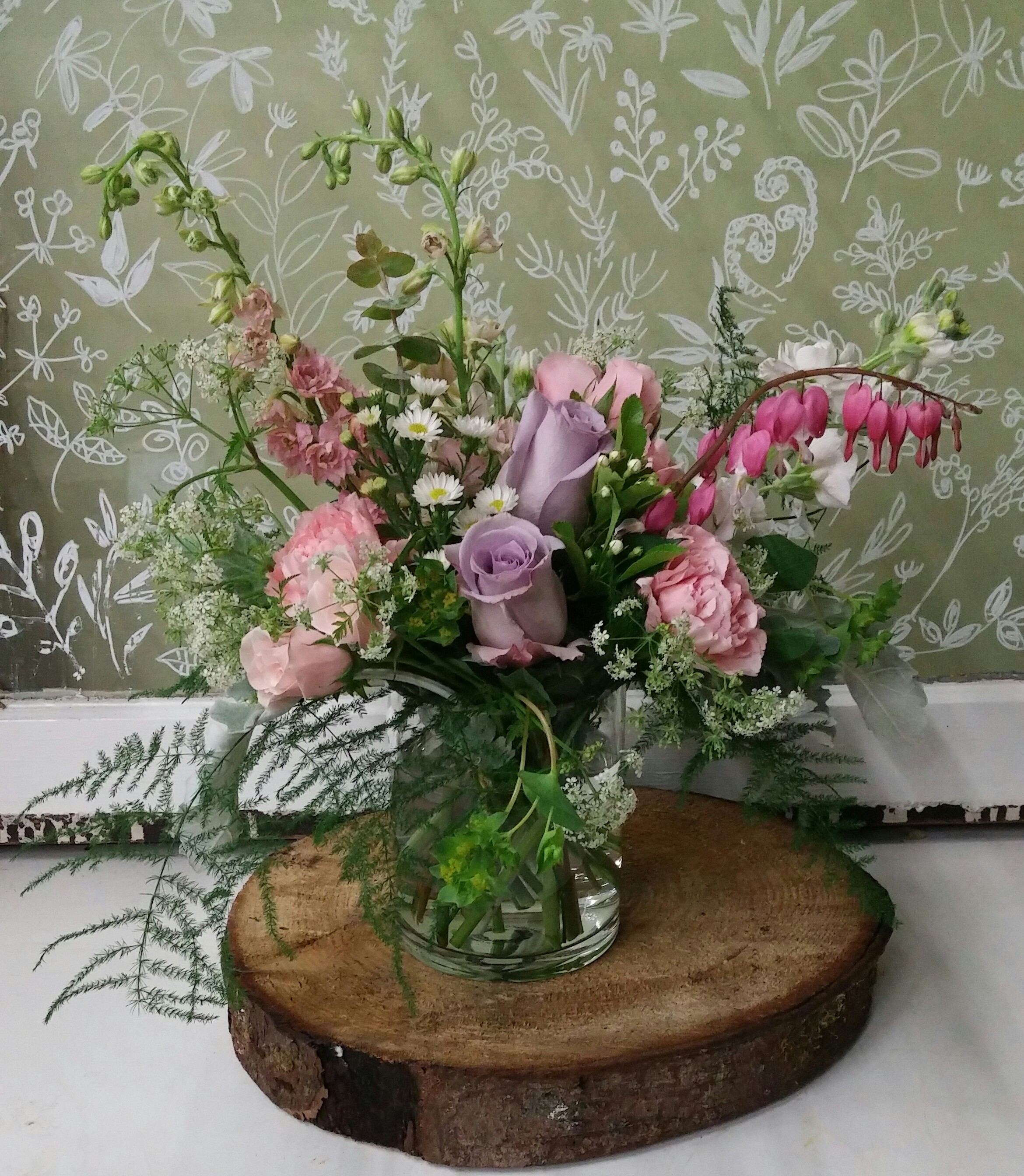 9. Pale lavender and pink summer bouquet with bleeding heart