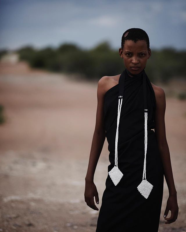 Skepoleina wearing the Jewels of the Kalahari collection made out of ostrich eggshells in Botswana, 2010 📷by Boo George. If you are interested in any pieces please contact me for more information. #weavingdivinityintomatter #zezecollective #sanbushmen #ostrichegg #naturalmaterials #ancient #firstdiscoveredjewelleryinhumanhistory