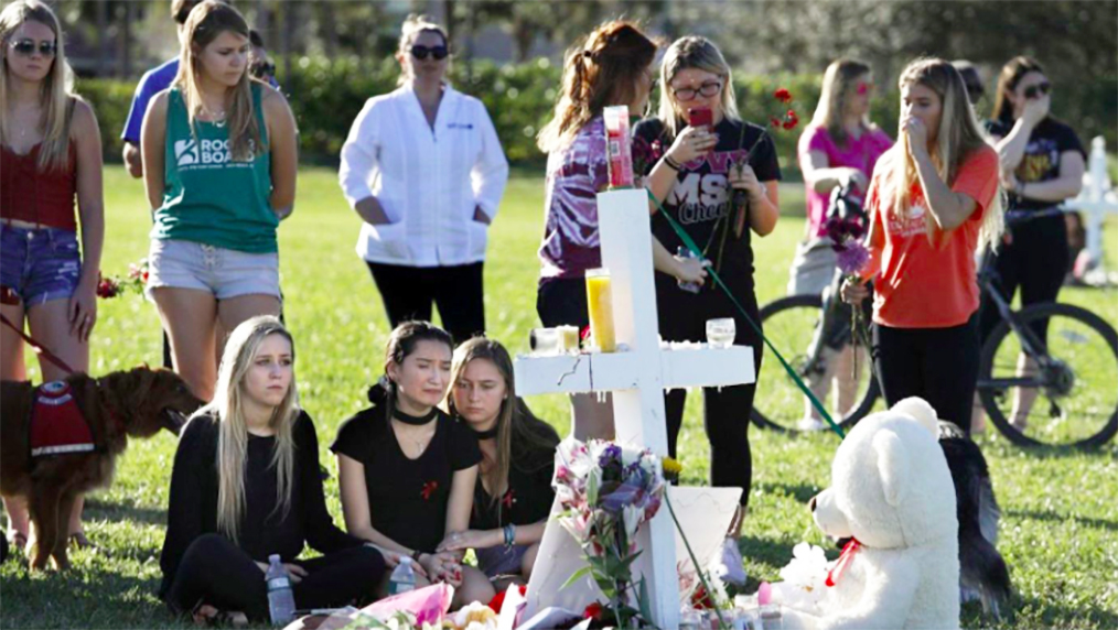 Students gather at a memorial at Pine Trails Park in Parkland, Fla., to remember those who were killed and injured Wednesday in the Marjory Stoneman Douglas High School shooting.  (Carolyn Cole / Los Angeles Times)
