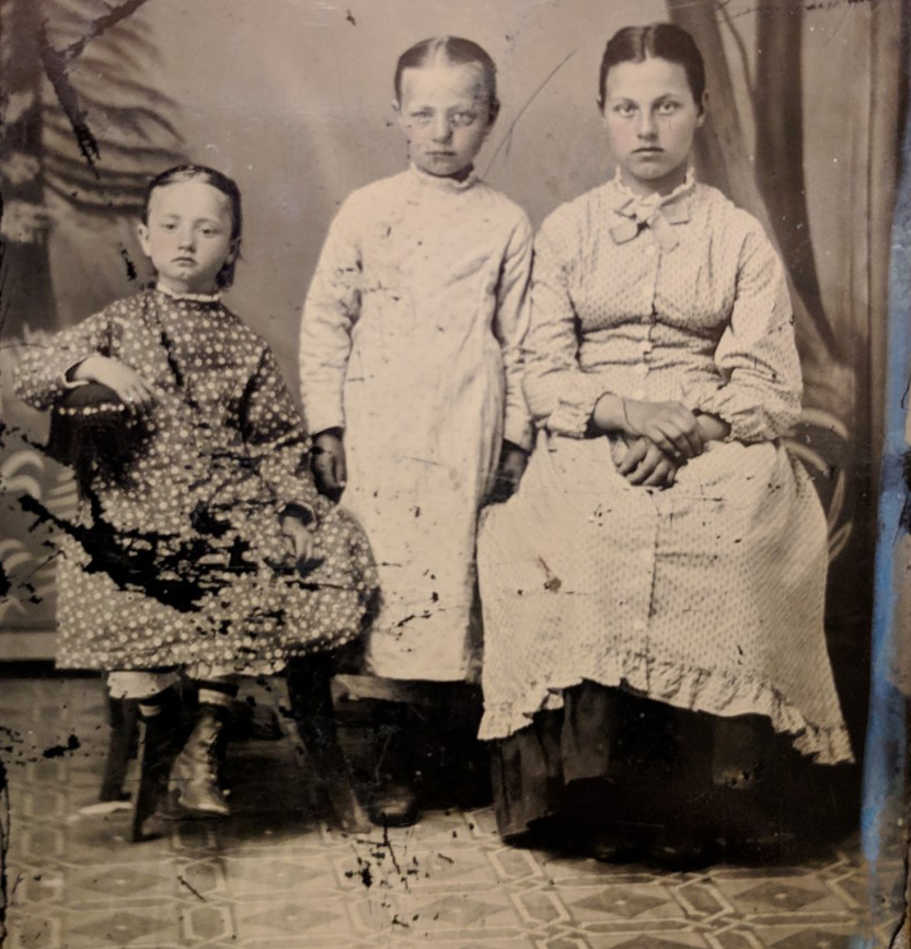 Christine Johnson (left) with her sister (middle) at the Norwegian Settlement at Mondovi, Wisconsin, ca. 1879.