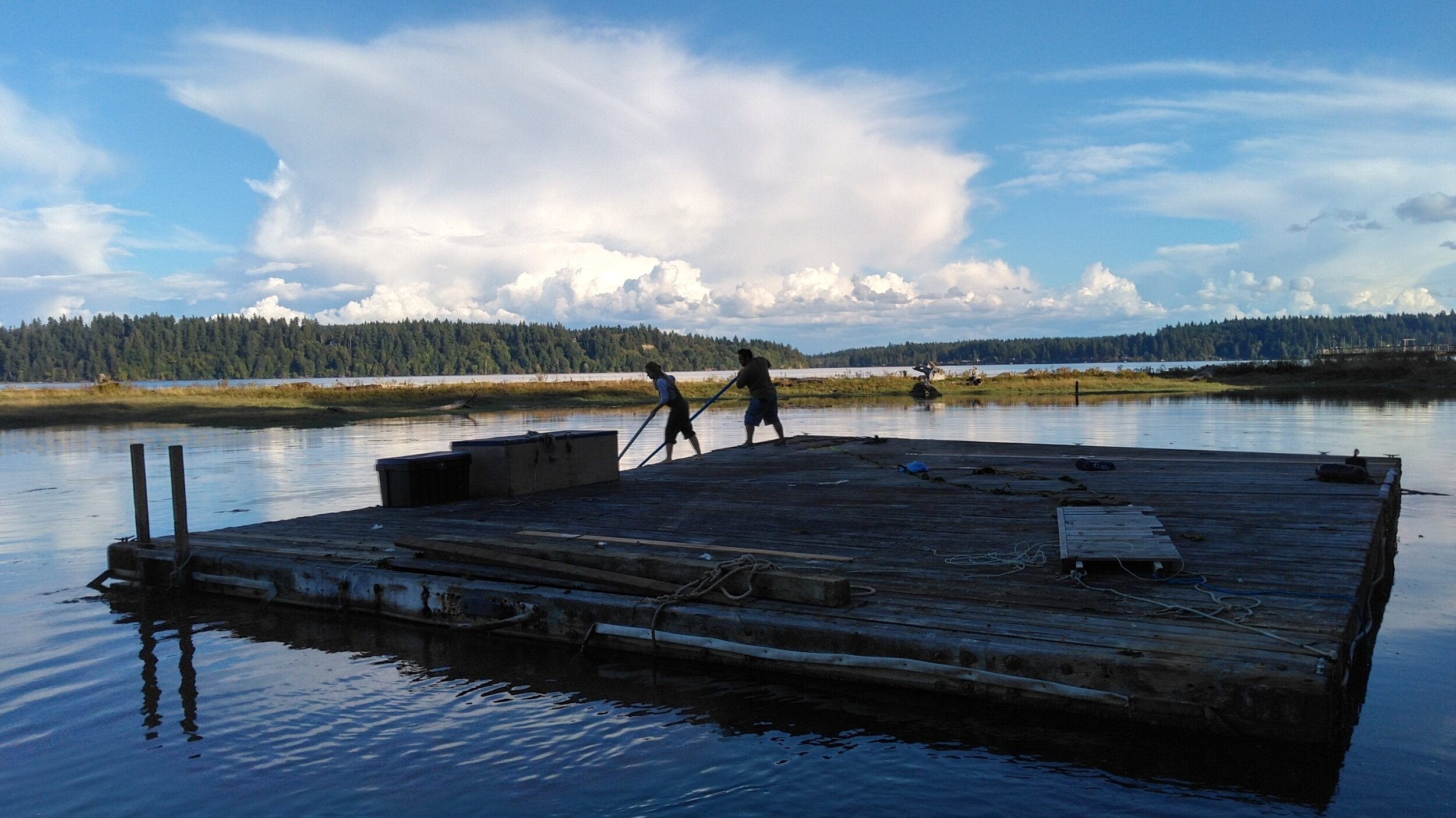 Nancyrose and James moving the dock into the lagoon