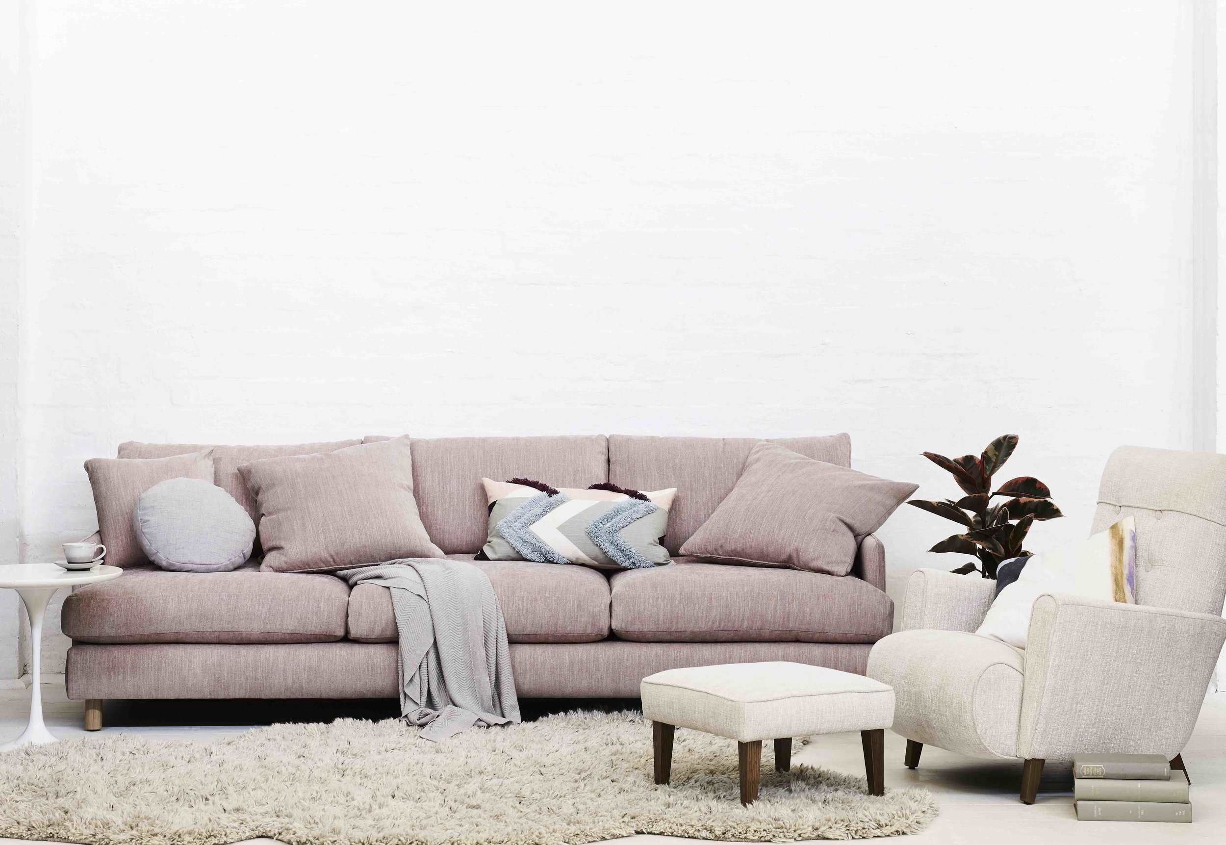 Molmic Rydell 4 seater sofa with Bonnie armchair and Ottoman.