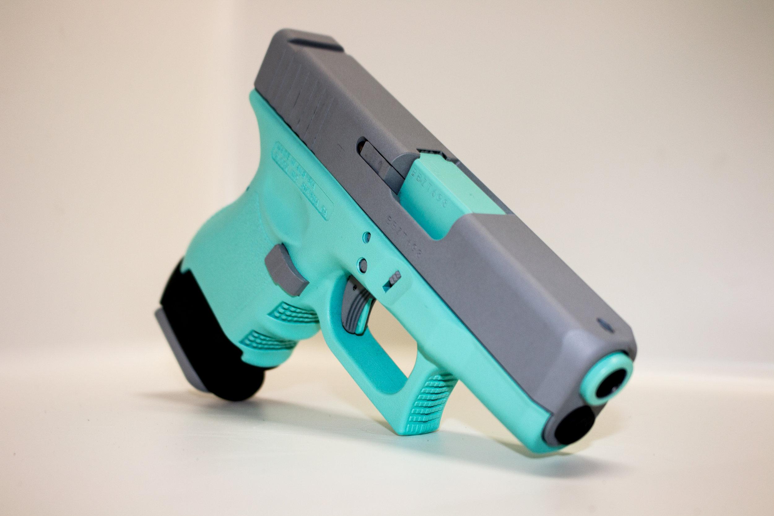 Glock-in-Teal.jpg