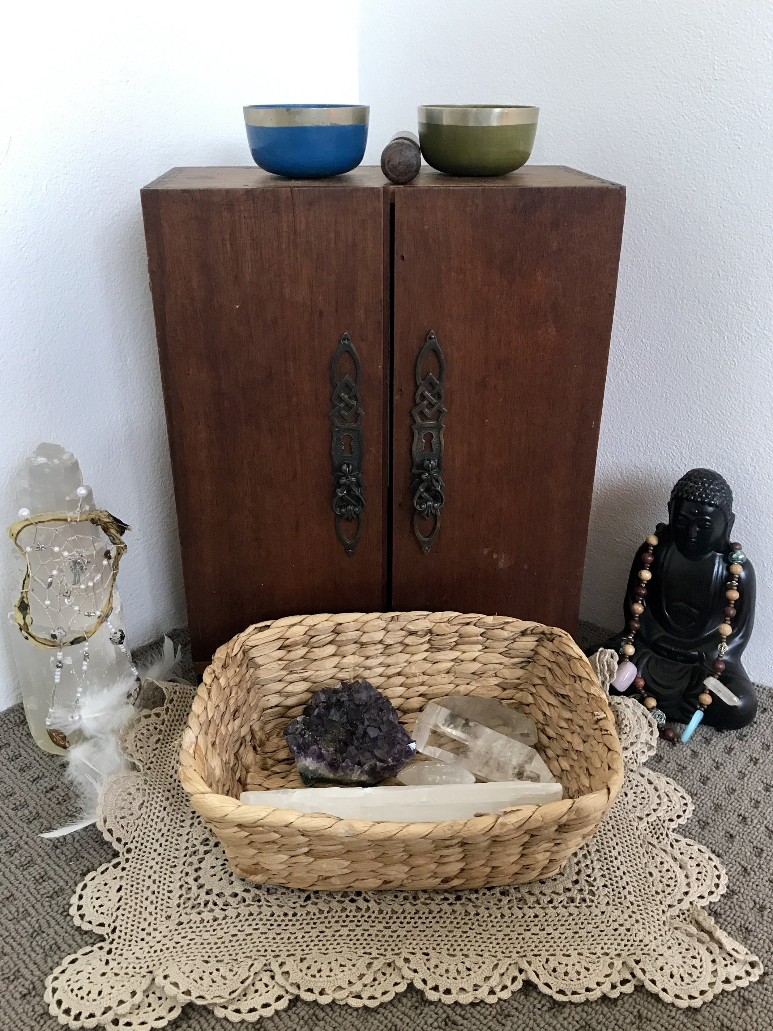 Our Buddha on the right, wearing the Birthing Necklace my soul sisters made for me at my Blessingway - and our Umbilical Chord Dreamcatcher hanging on our Selenite Crystal on the left.