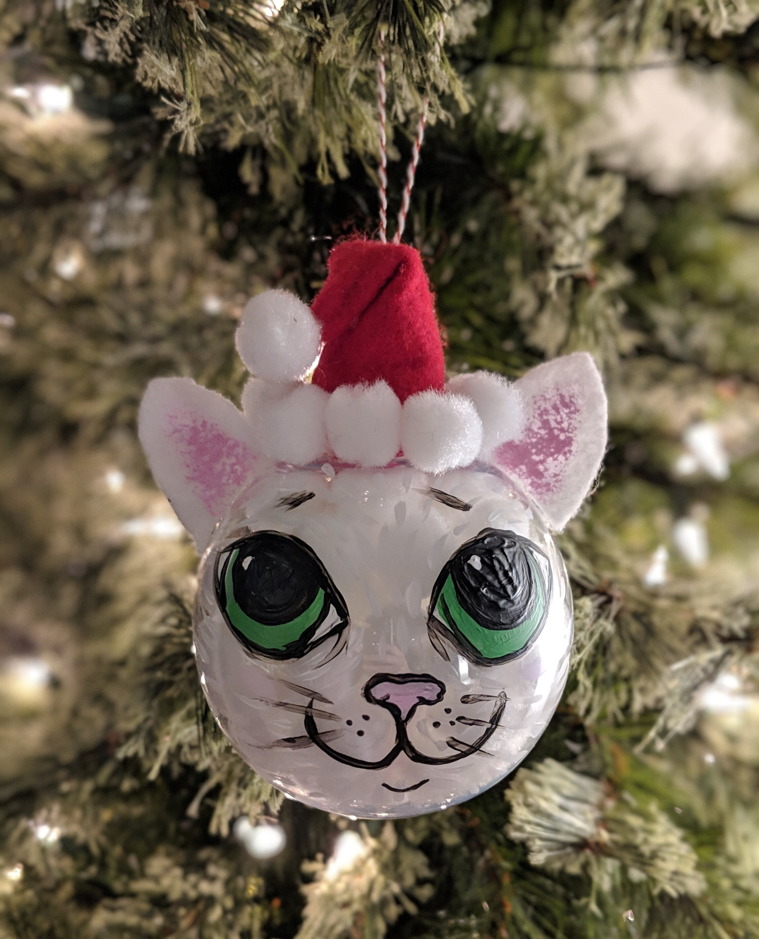 Be creative and create your own kitty-inspired tree ornament! It's easy; I just used a little hot glue, felt, paint, and some poms and string to hang. Meowy Christmas!