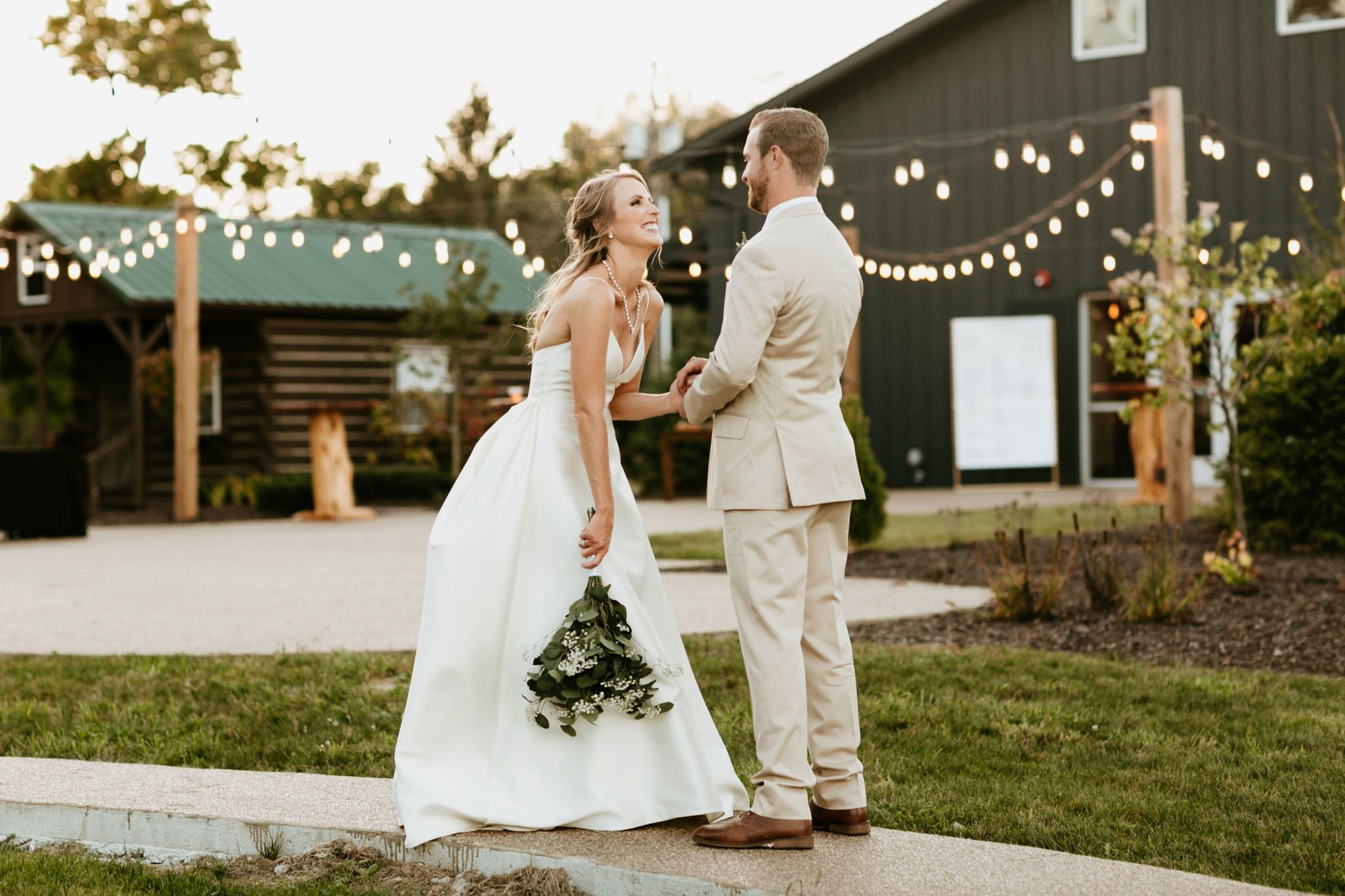 bride-and-groom-laugh-during-wedding-at-finley-creek-vineyards