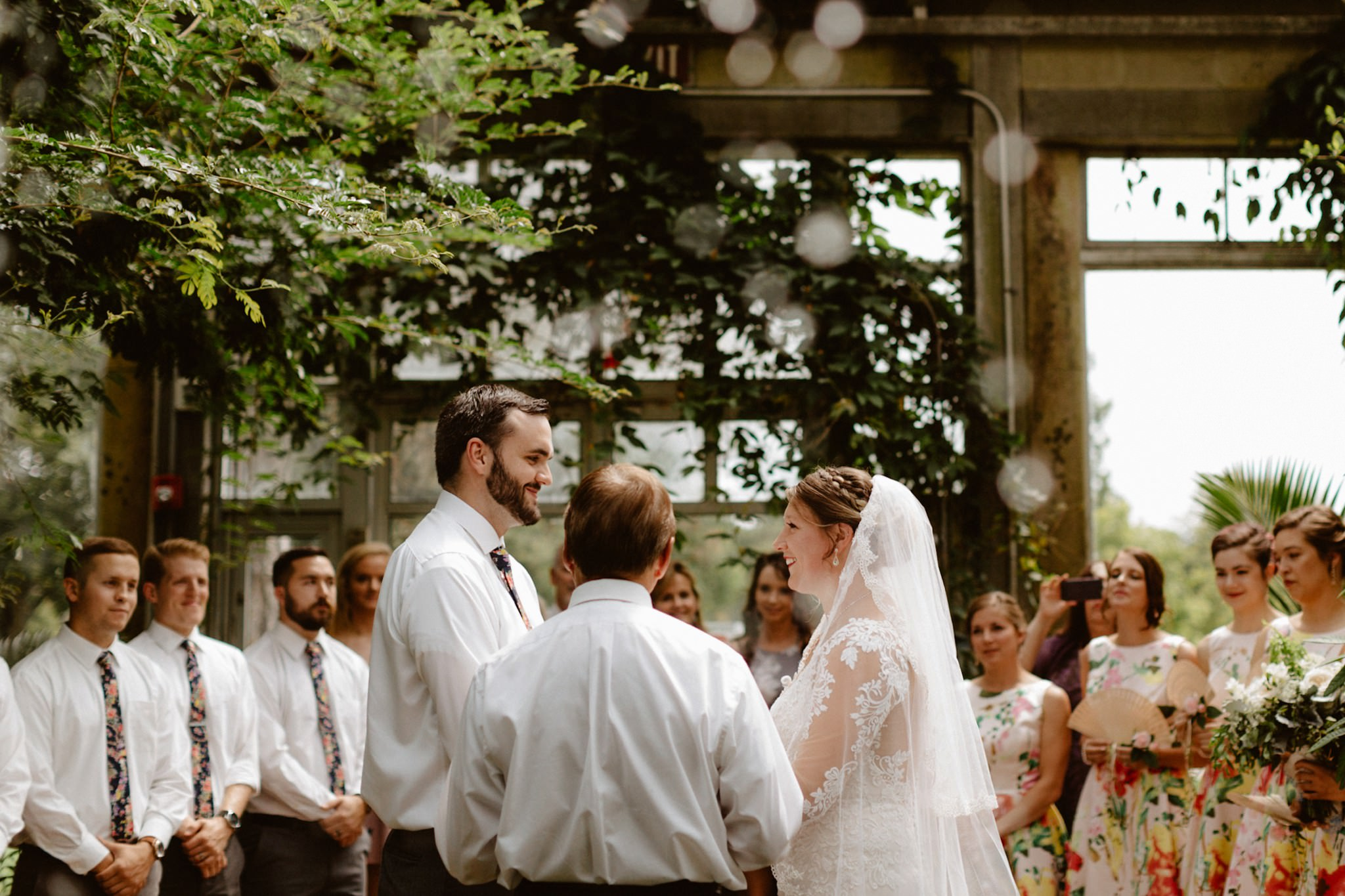 happy-bride-and-groom-say-i-do-at-garfield-park-conservatory-indianapolis
