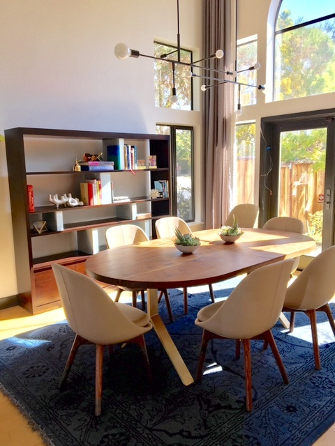 """I like this bookshelf and dining table from a project in Alameda. The bookshelf has contrast dividers that we painted in a custom color. The dining table is a racetrack walnut surface on brass legs."" --Taylor"