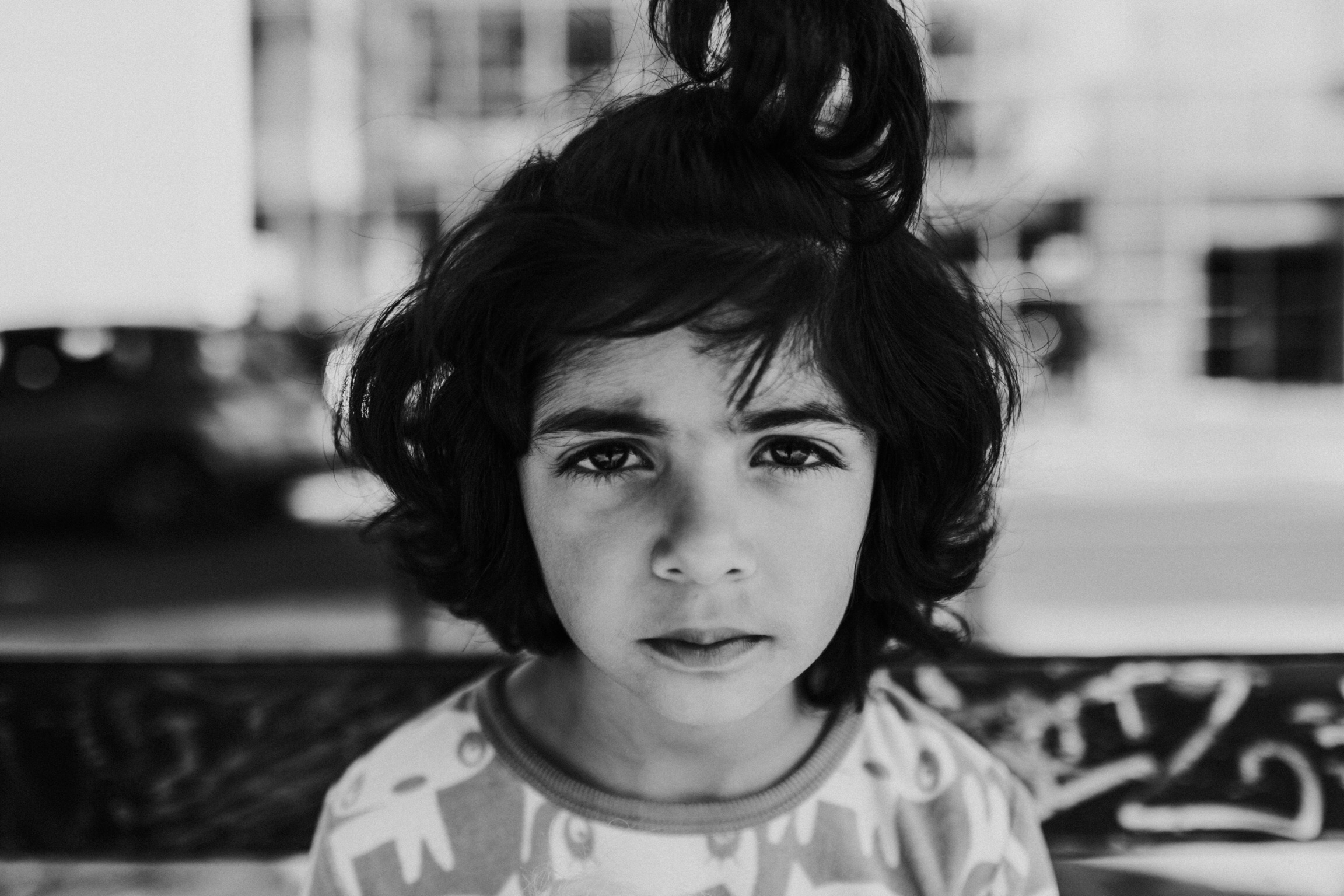 2, 5, 6, 7: 3 sisters ages 3, 5, and 7 recently arrived from Afghanistan. Their father, who asked to not be photographed, has been in hiding for 14 years.