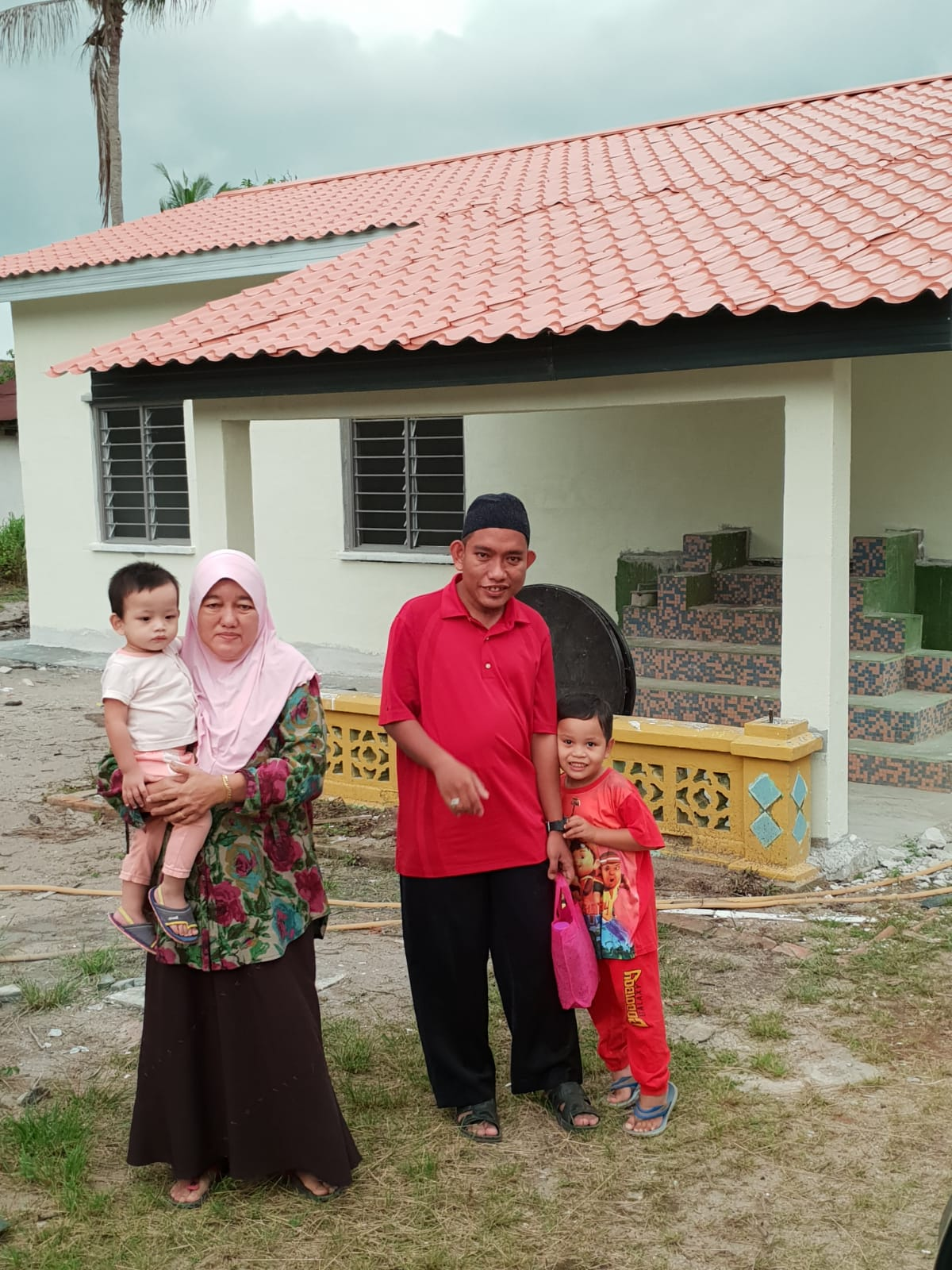 """Puan Habibah with her family."""