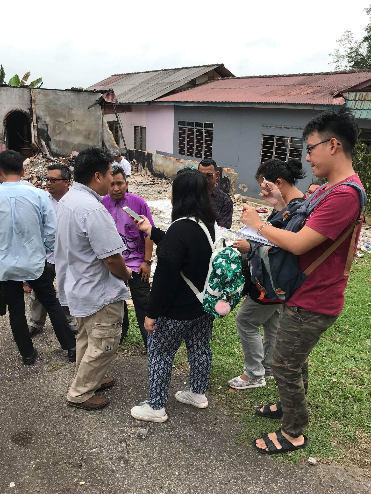 YB. Damien and Mr Joji Yang visit the site of the burning house
