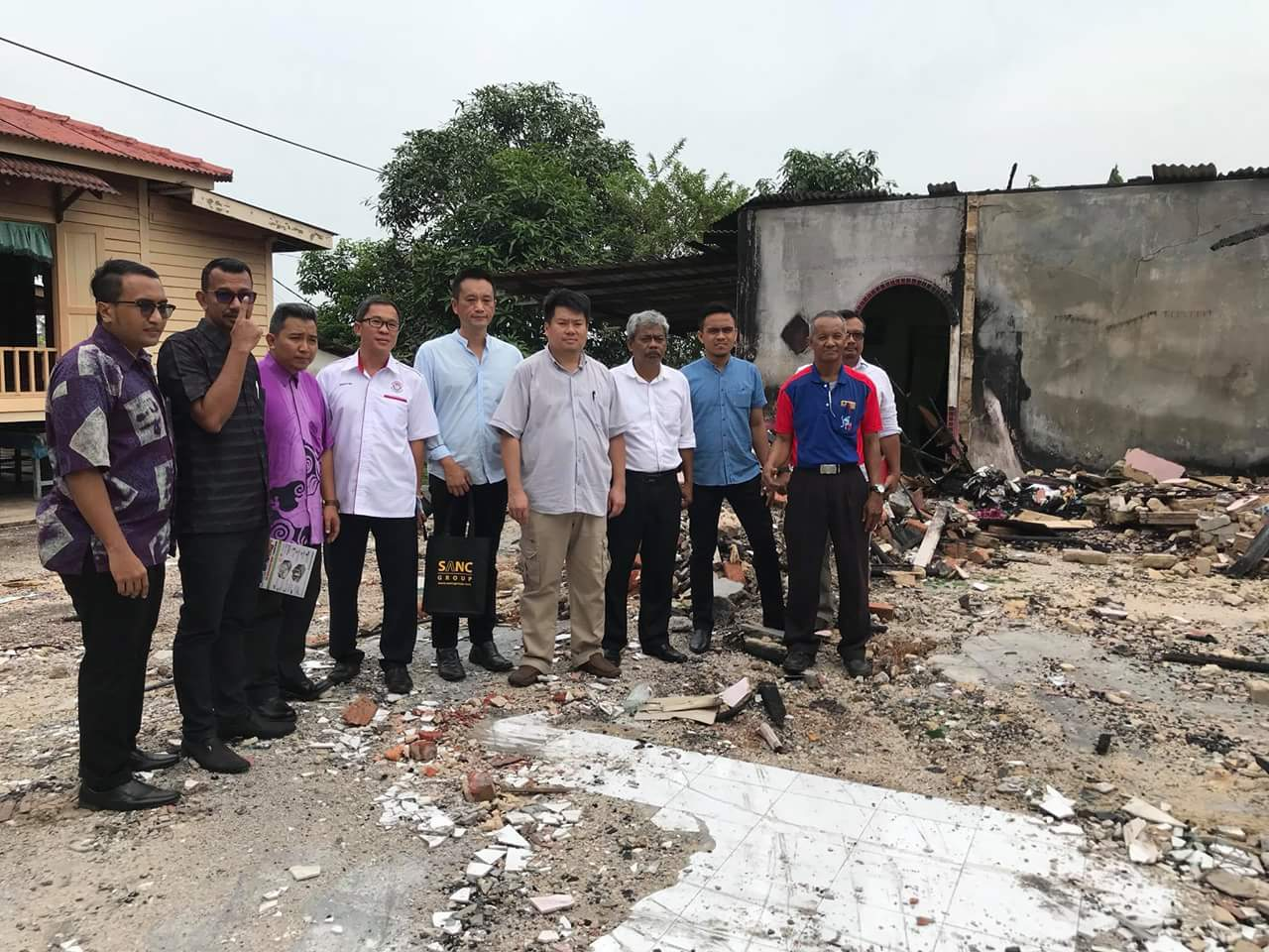 YB. Damien and Mr Joji Yang visit the site of the burning house.