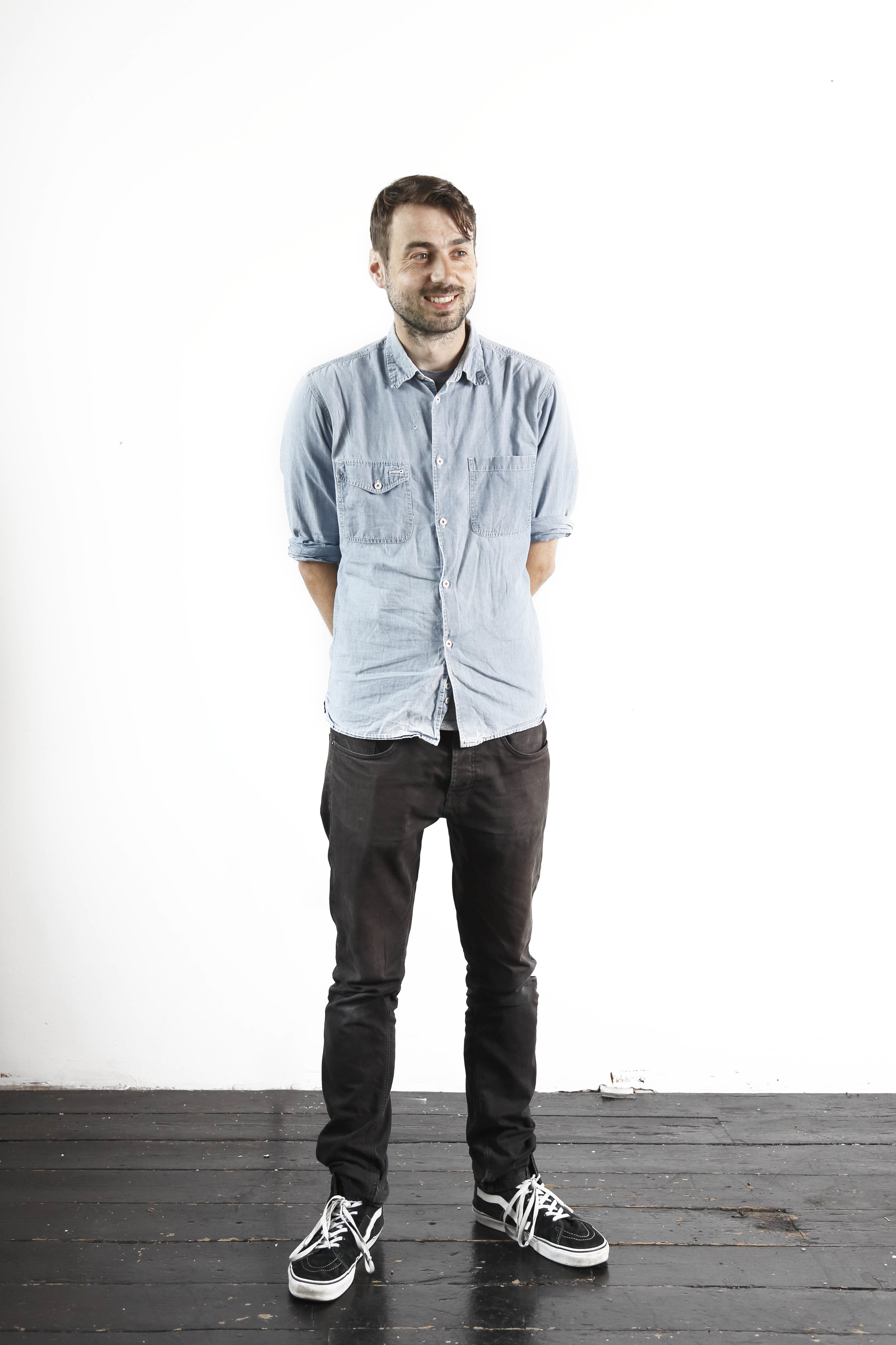Here's a picture of me standing awkwardly in front of a white wall a couple of years ago. I look a bit older now.