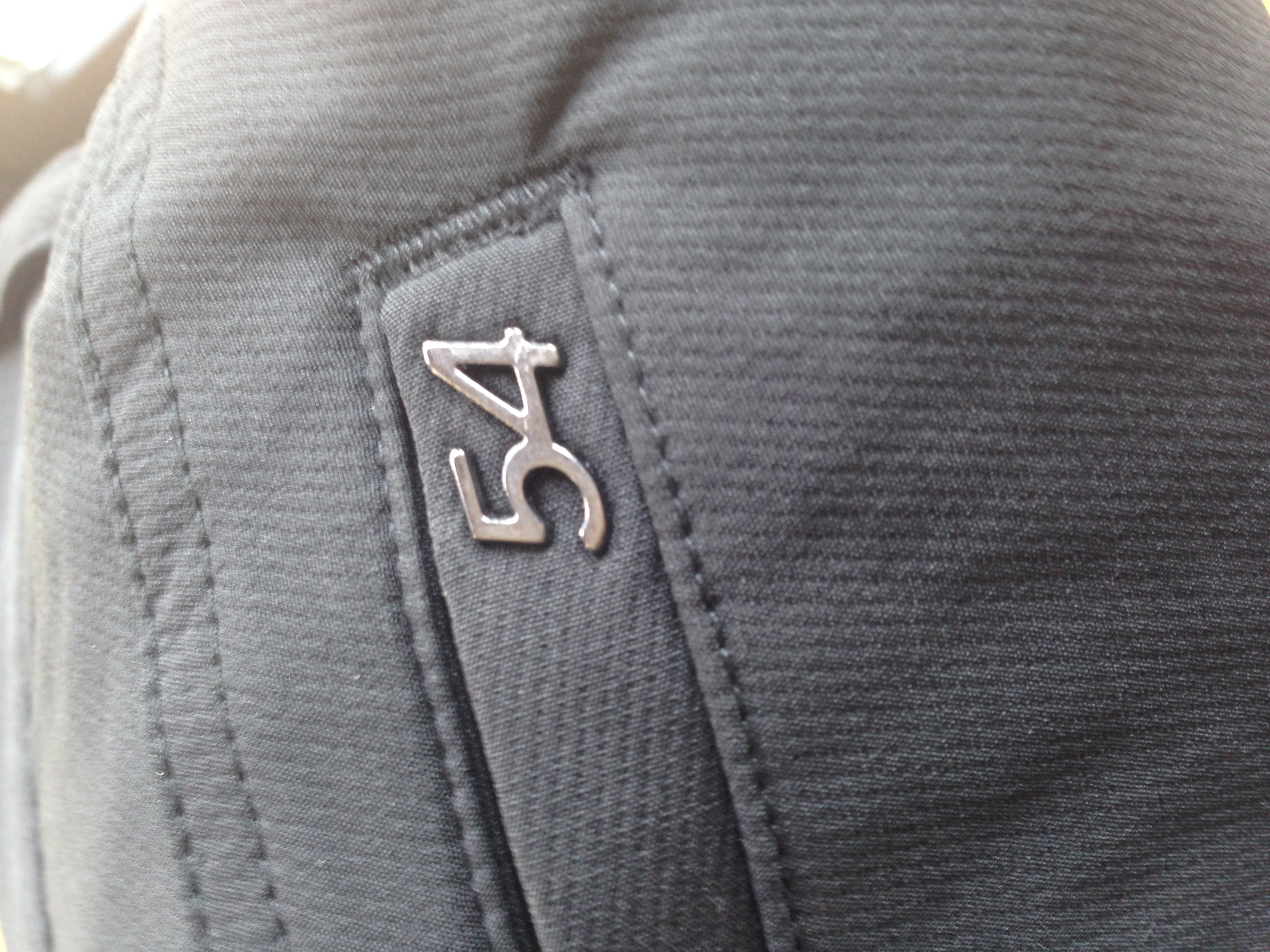 The Chase54 logo on the back pocket of the Norris Trousers