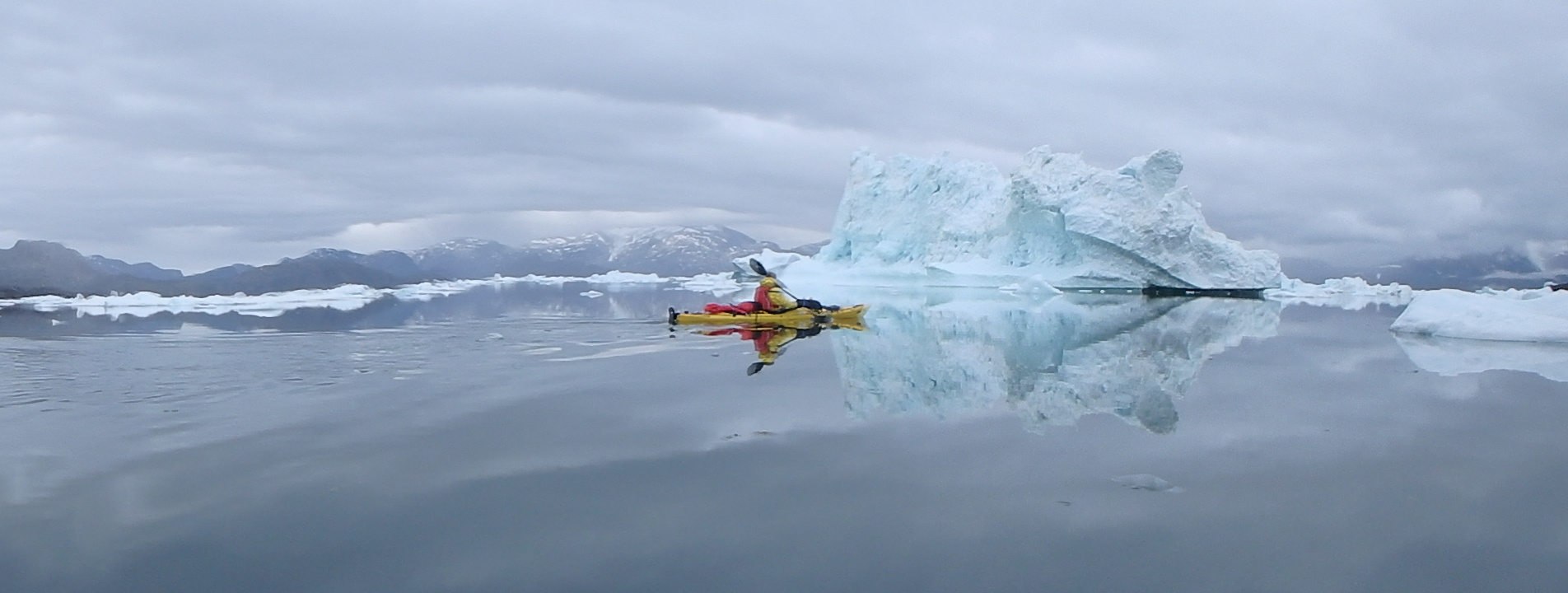 With mirror like seas which are not uncommon in Greenland.