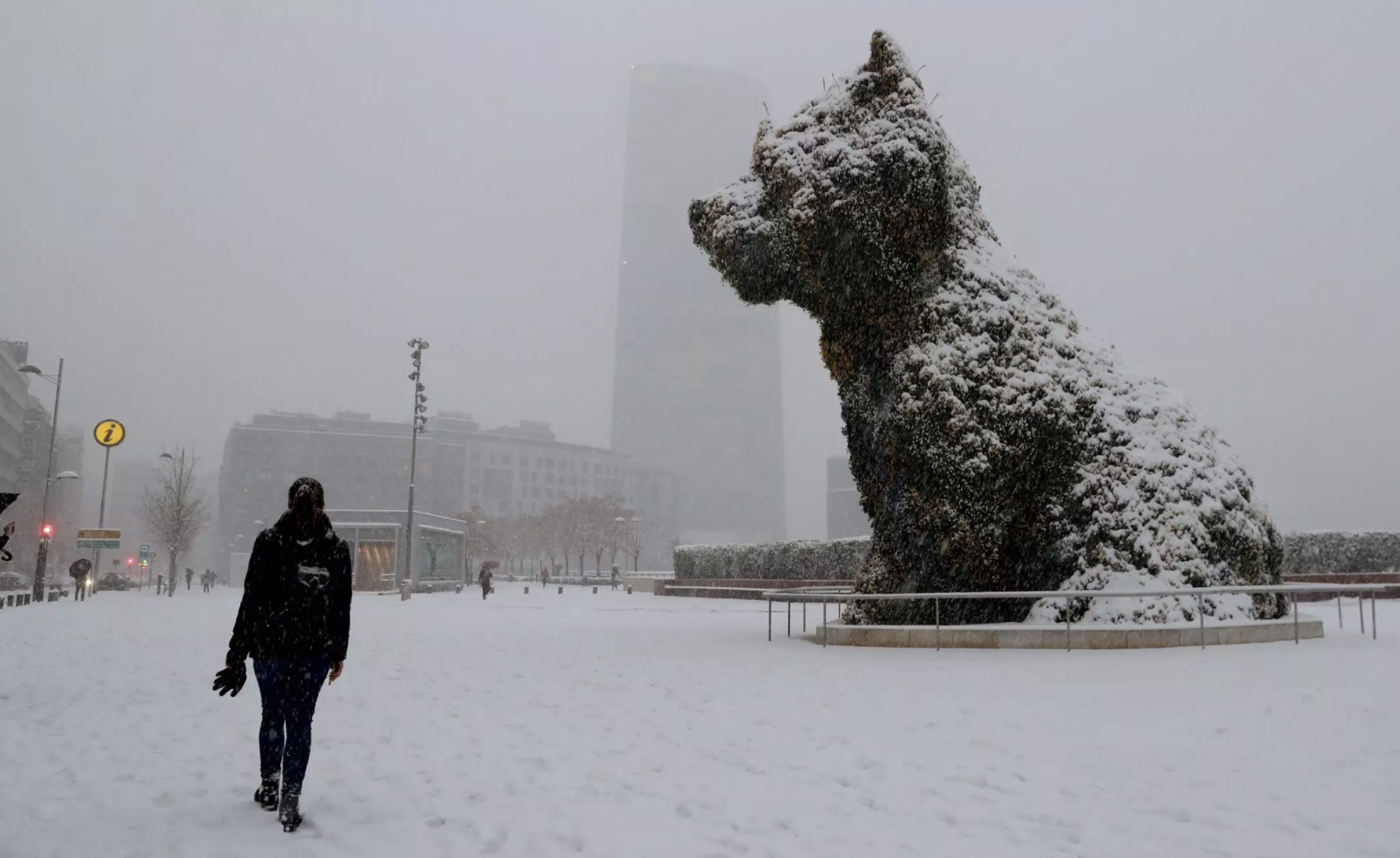 A puppy sculpture by Jeff Koons was covered with snow in Bilbao, Spain. CreditLuis Tejido/European Pressphoto Agency