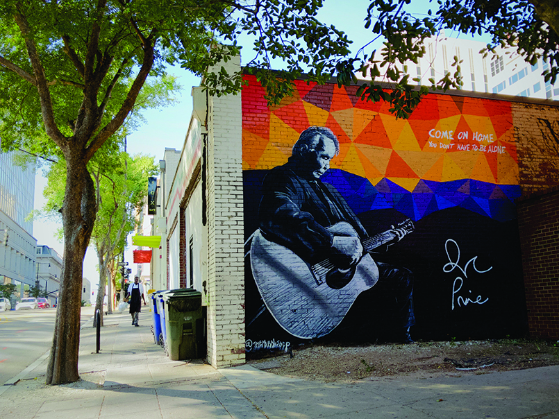 John Prine by Scott Nurkin was painted during the 2018 World of Bluegrass International Festival. This project is a collaboration between Oh Boy Records (John Prine's label) and the Raleigh Murals Project (with help from Jeremy Clark). (Photo by Jeremy Clark)