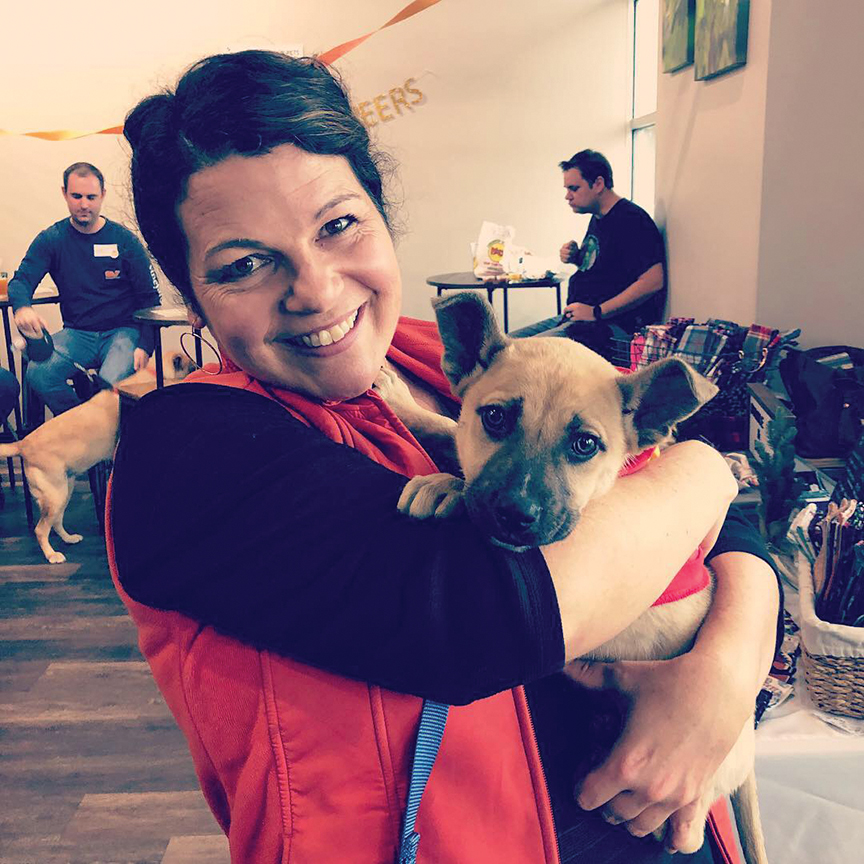 Owner Lesley White with Paw Prints adoptable puppy, Brewster (who got adopted from the event!).