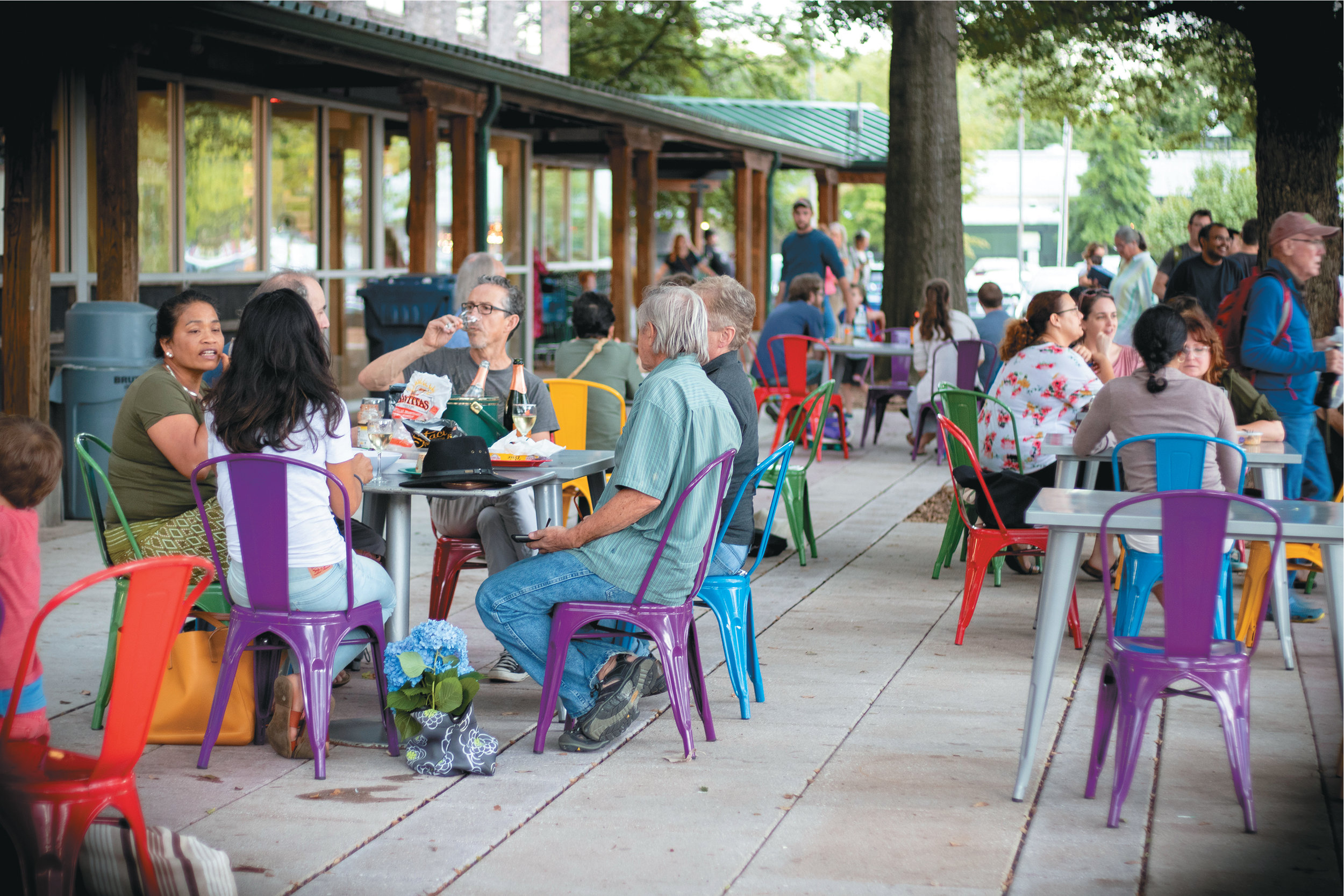 outdoor seating area at  weaver street's flagship store in carrboro