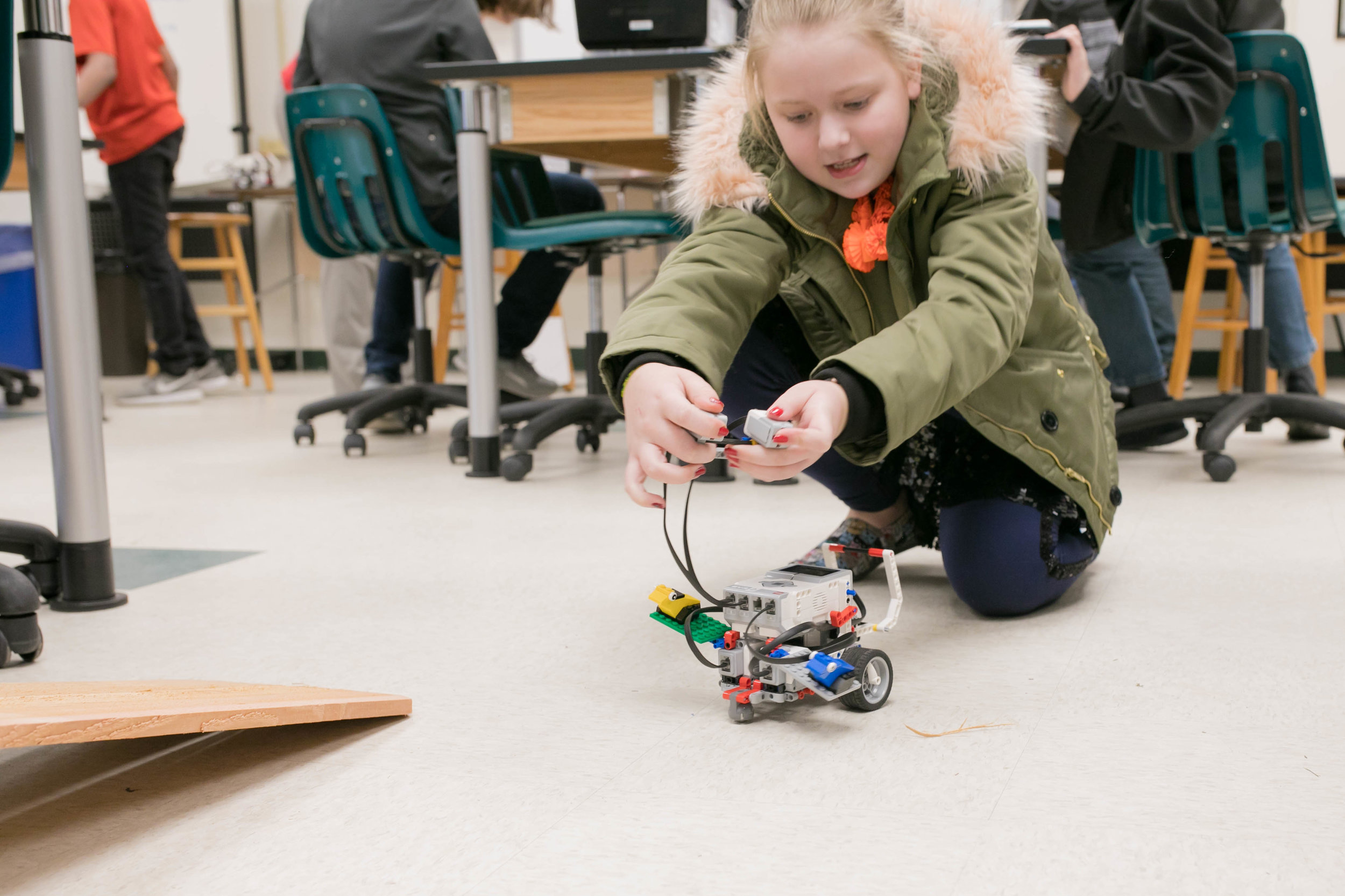 ravenscroft school students work with lego robotics in the school's middle school engineering class. Photo by Laura B. Hunter Photography