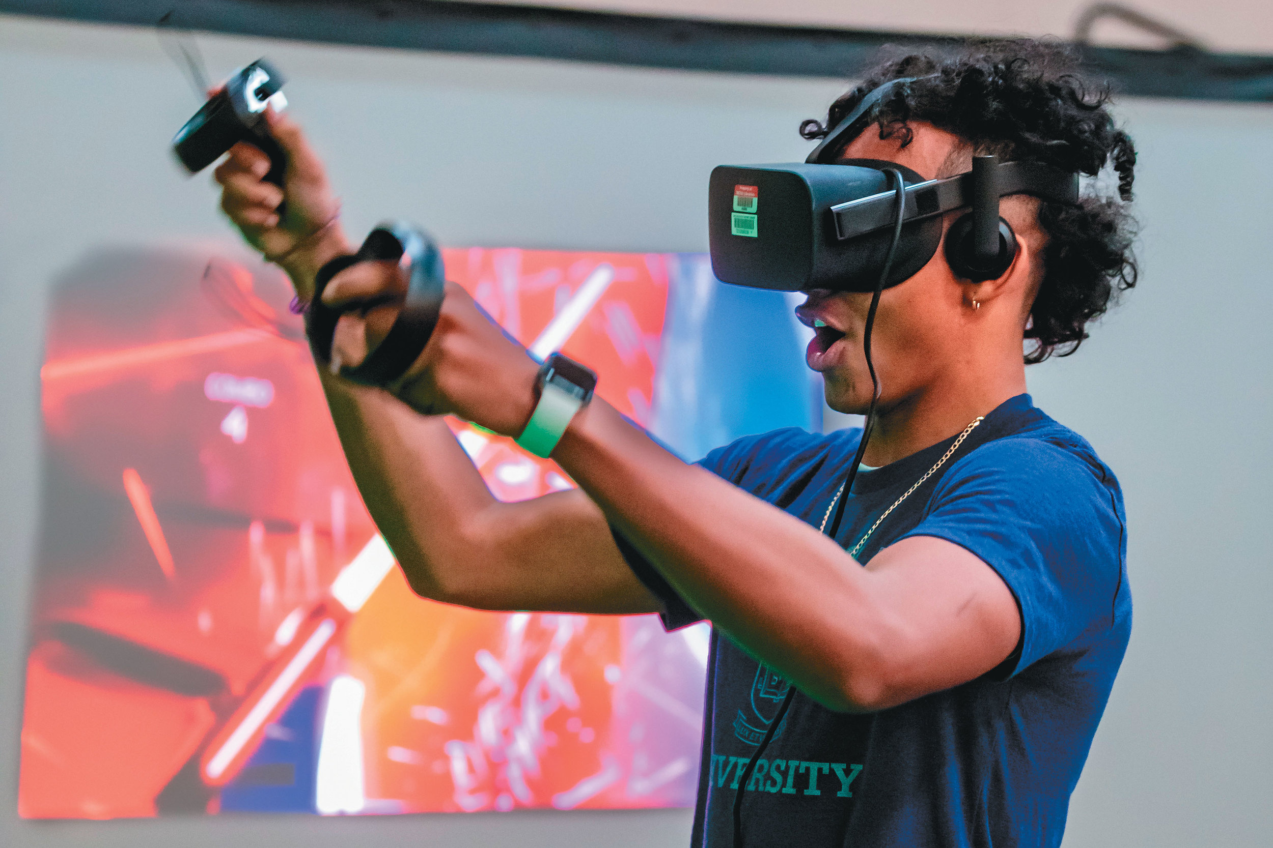 Athens Drive magnet High School Student Chase Graham participates in a virtual lightsaber battle at the school's 2018 Stem Wars Day, thanks to NC State's Computer Science program. (Photo by Paul Cory/WCPSS Communication)