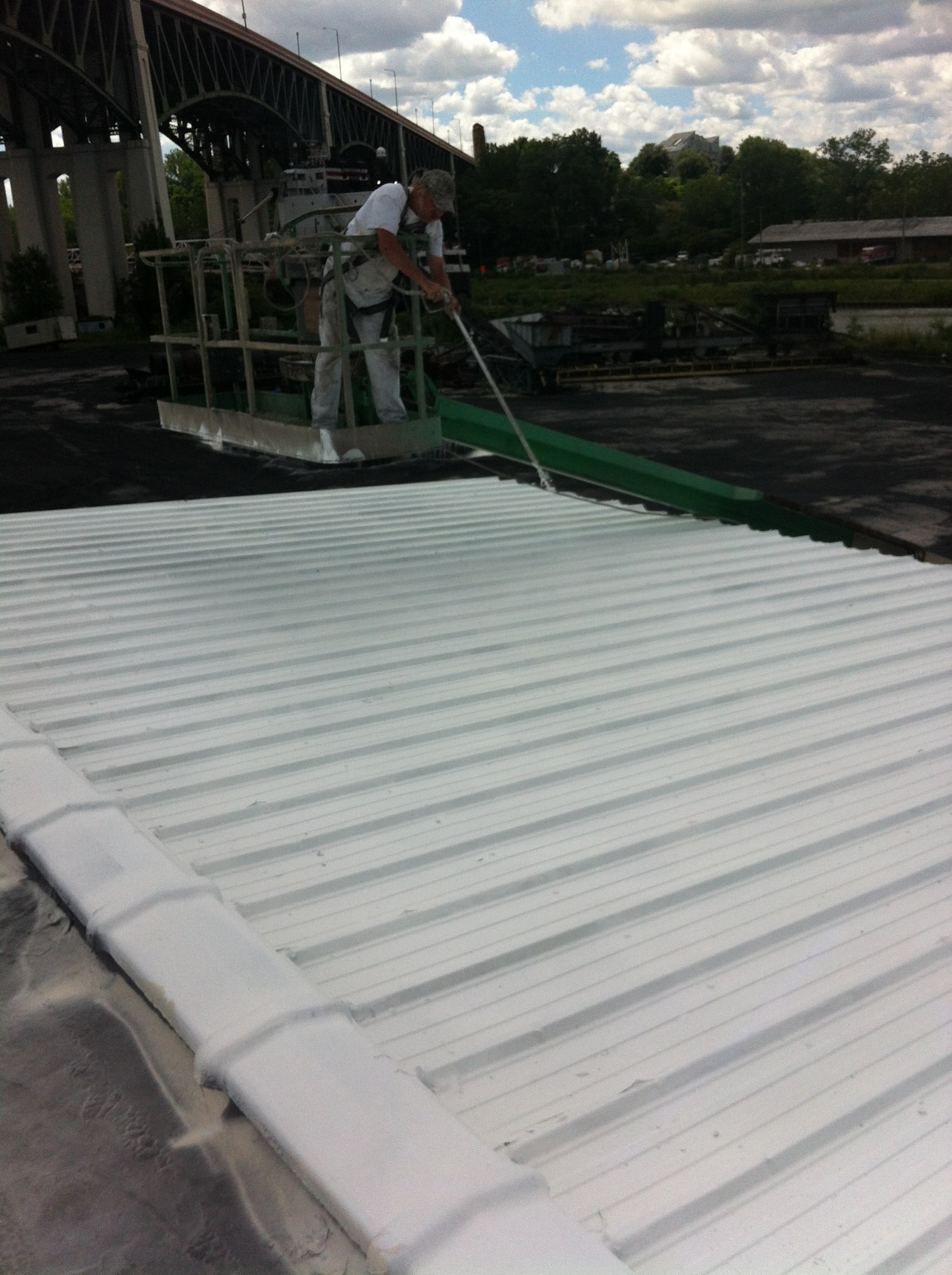 Application of Uniflex coating to metal roof at Mid Continent Coke in the flats.jpg