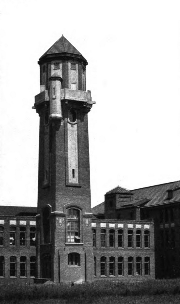 H_Black_and_Company_building_-_SW_view_of_water_tower.jpg