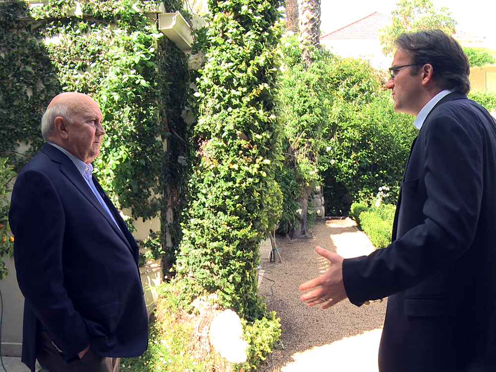 Director Nicolas Rossier talking to F.W. de Klerk at the former president's garden in Cape Town